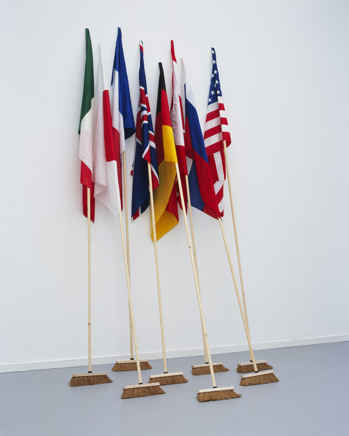 Mounir Fatmi   G8-The Brooms (Contamination) , 2008 12 wood sticks 3 meters high, 8 national flags, 4 black flags (150 x 100 cm each) dimensionsvariable