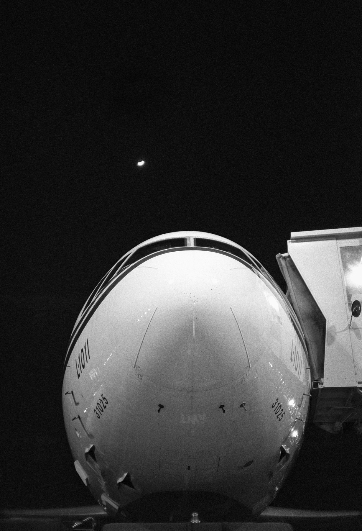 Lucien Samaha   Moonrise Over Lockheed - JFK (The Flight Attendant Years) , 1982, printed 2013 archival pigment print 49 x 35 inches 124.5 x 88.9 cm