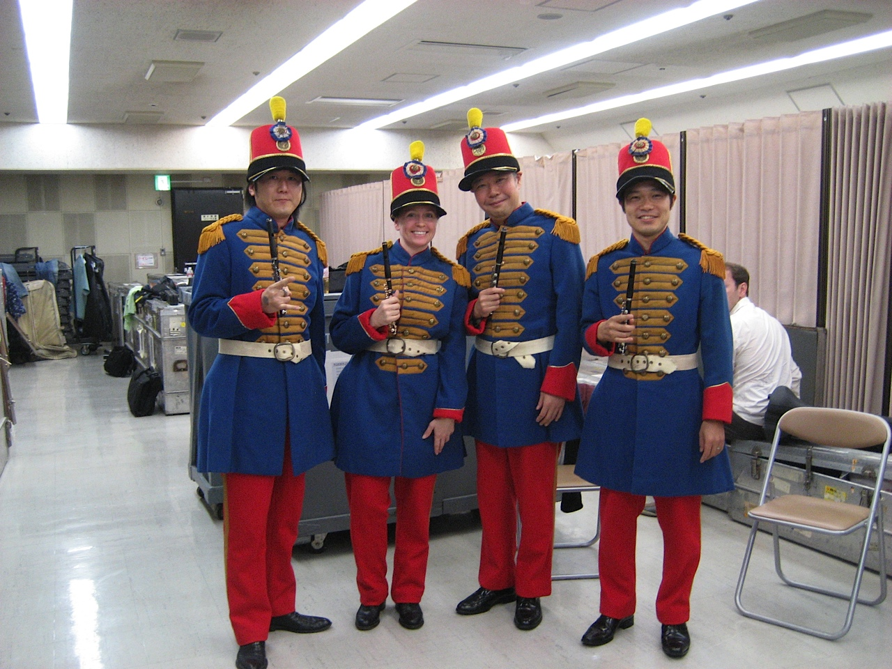 Stephanie poses with the piccolo section in Japan, 2011. These smiling piccoloists add marching in lockstep to the list of circumstantial variables affecting intonation.