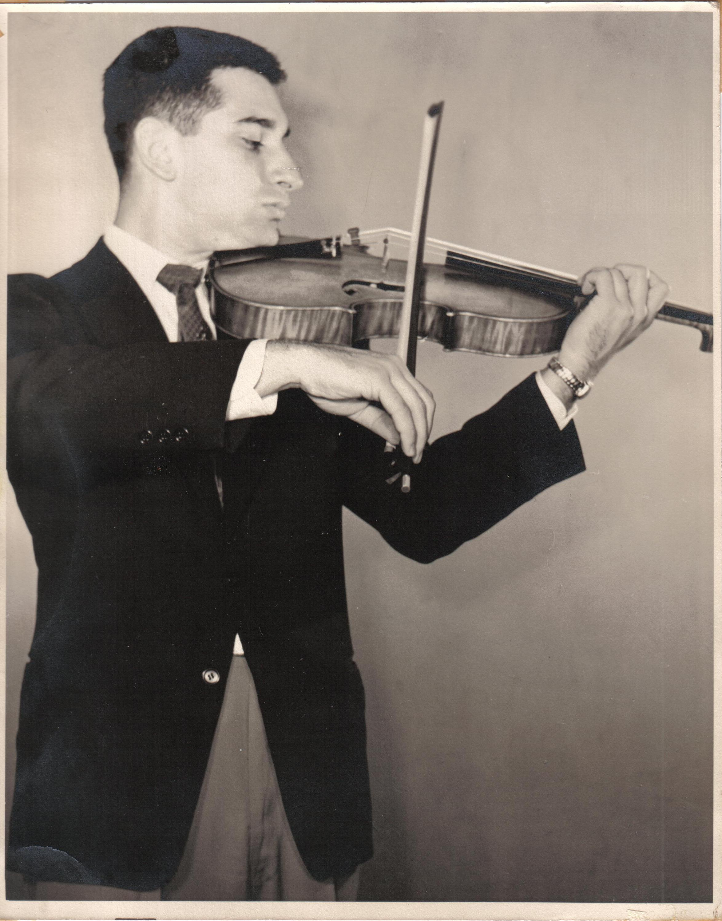 C. Victor Lionti in 1954 ; at this time, the elder Mr. Lionti was a member of the viola section of the Rochester Philharmonic Orchestra under MET conductor Erich  Leinsdorf , while a senior at the Eastman School of Music (and classmate of future MET concertmaster Raymond  Gniewek )