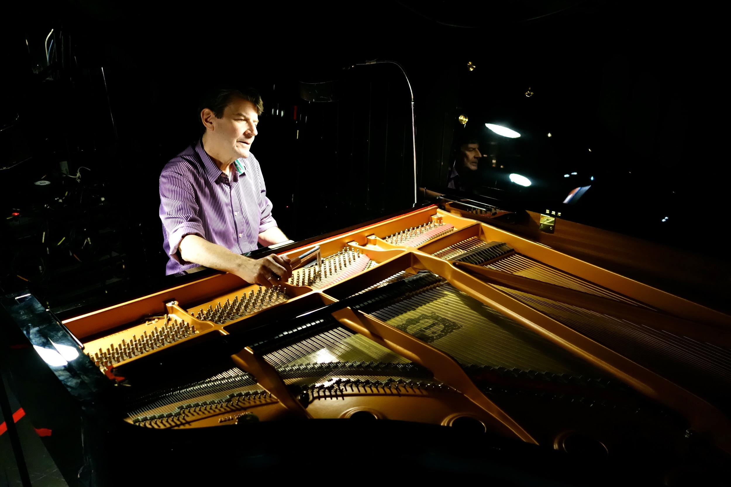 Two hours before the curtain rises for Lulu, Christopher Kennedy tunes the piano used in the pit. Photo by Jennifer Johnson.