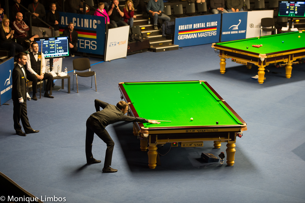 Judd Trump knocks in the final black of his 147
