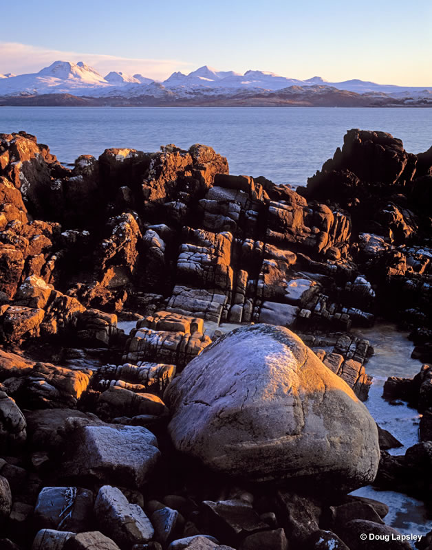 Icy bolder and Torridon mountains from Gairloch