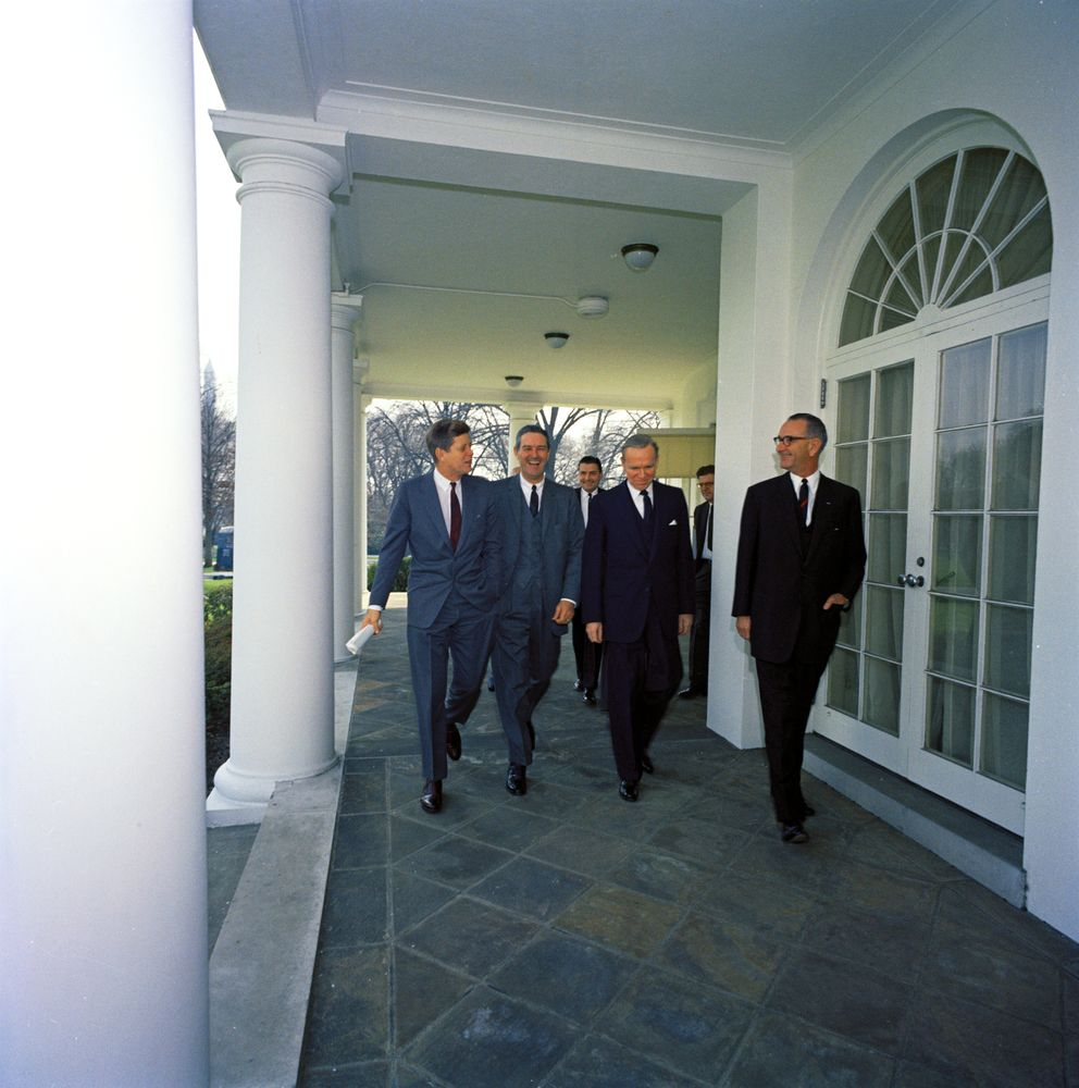 lbjlibrary :     March 1961 - President Kennedy walks with Vice President Johnson and members of the Dept. of Defense down the West Wing Collonade, to sign a bill restoring the rank of 5-star general to former President Dwight D. Eisenhower.    From left to right: President John F. Kennedy; Secretary of the Navy, John Connally, Jr.; Secretary of the Army, Elvis Jacob Stahr, Jr. (in back); Deputy Secretary of Defense, Roswell Gilpatric; Vice President Lyndon B. Johnson.    John Connally  was an old ally of LBJ's, having started as an aide to him in 1939 and playing a role in many of his campaigns after that. Connally served as Kennedy's Secretary of the Navy from Jan-Dec 1961, when he left to run for Governor of Texas, a position which he won.    Photo via JFK Library .