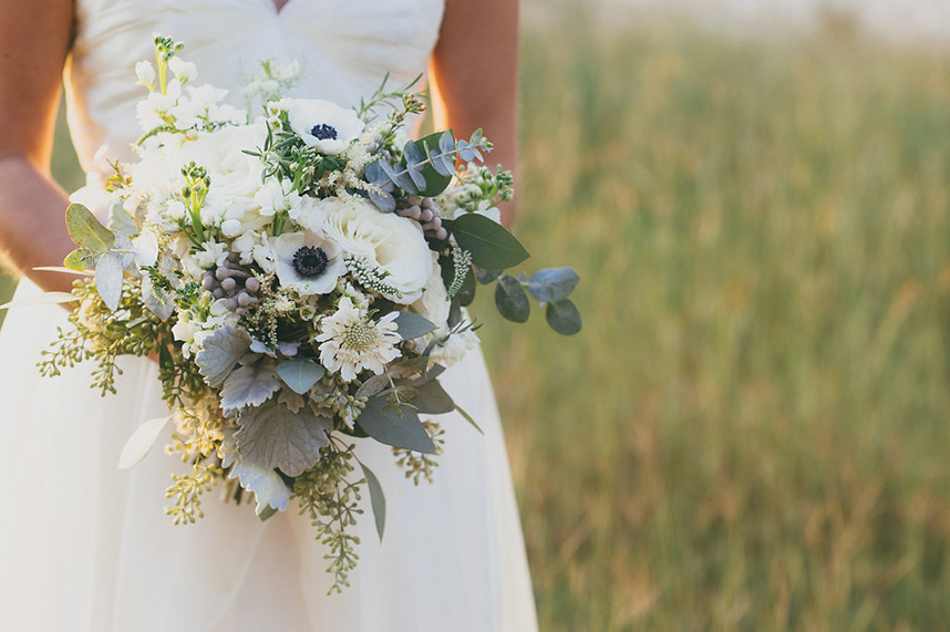 Bohemian style, wildflower inspired bridal and bridesmaid bouquets with eucalyptus, white anemone, ranunculus at Vista West Ranch. Petal Pushers floral event design studio located in Dripping Springs, Texas.