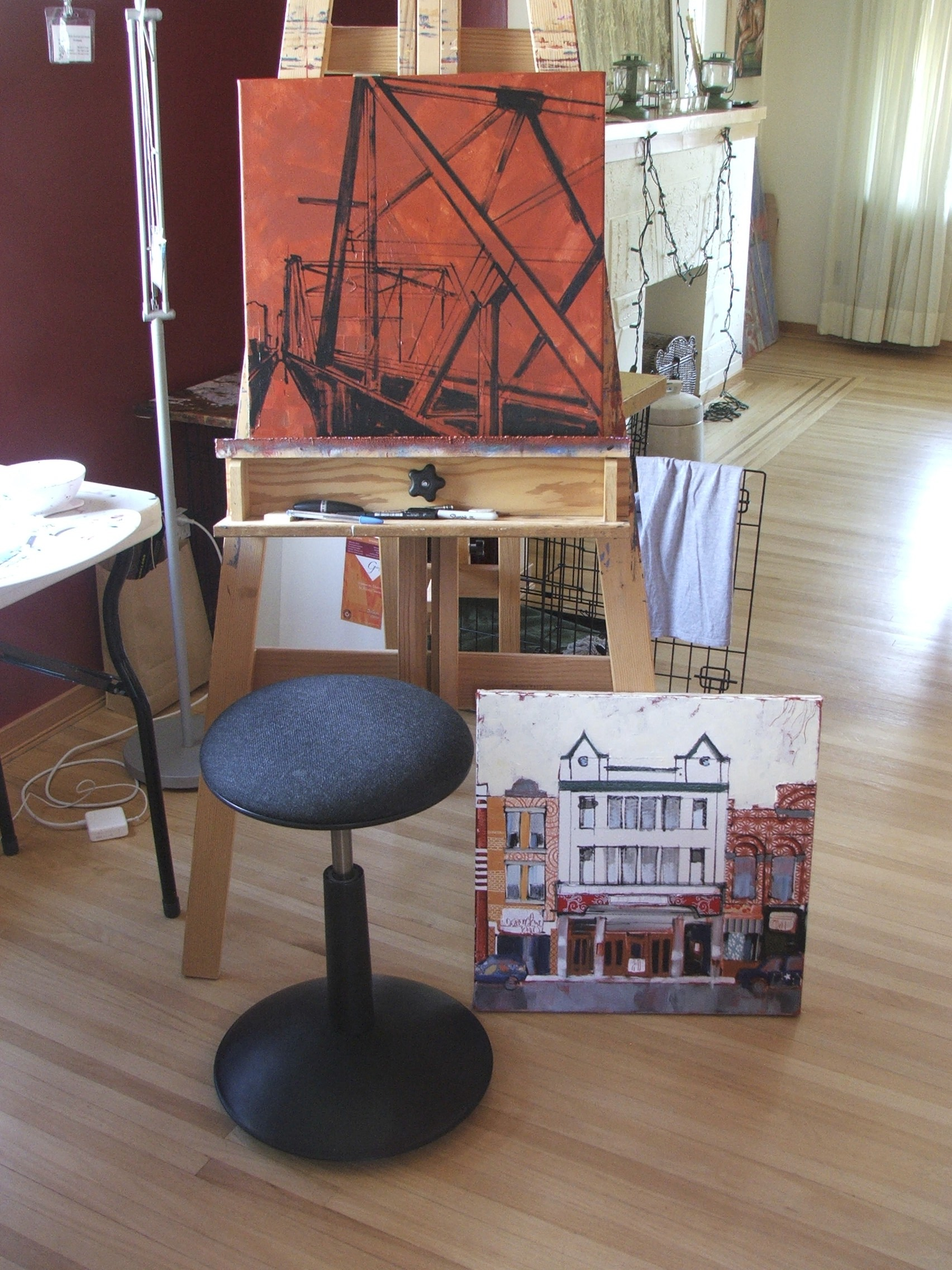 the piece on the easel is the outline from one of the photos i took today of the Walterdale Bridge here in Edmonton. i believe this old trestle bridge is being replaced this summer, so i'd like to capture it in a few painted versions just because i can. the piece sitting on the floor is an unfinished painting of the Princess Theatre. both canvases are 20x20(in).