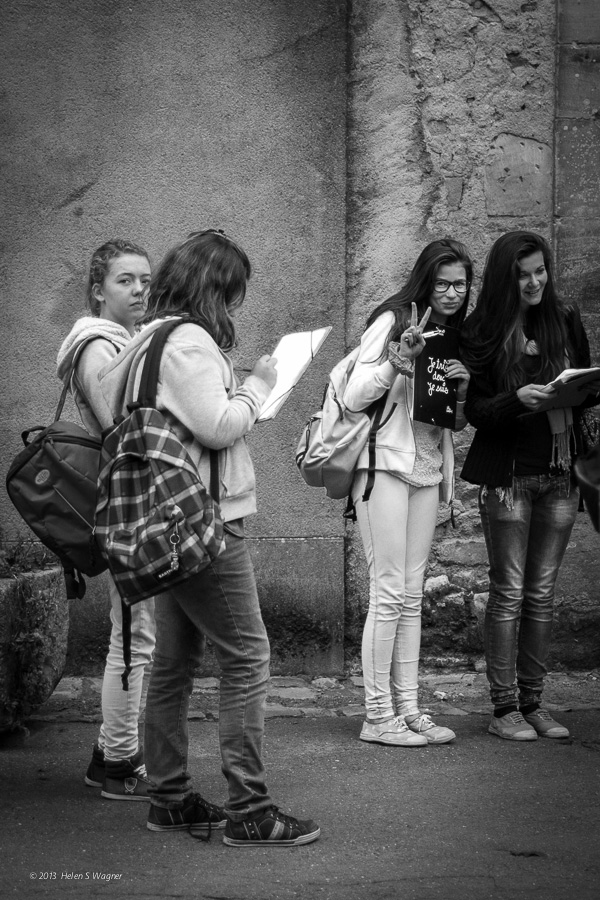 A young woman's peace / friendship gesture in Bayeux, France, invited me to keep my camera raised and make images of the students in the group.