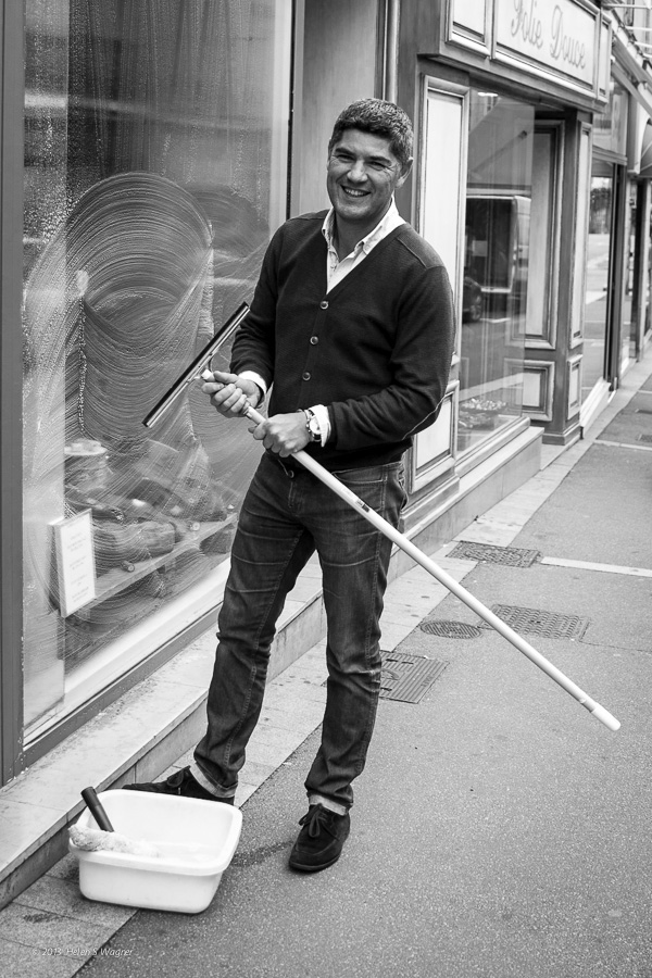 A man tidying his shop in Bayeux, France, was a great subject for an early morning portrait.