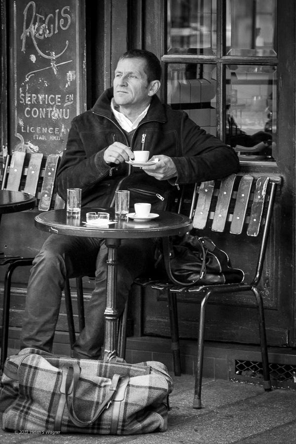 Enjoying a coffee at Île Saint-Louis in Paris.