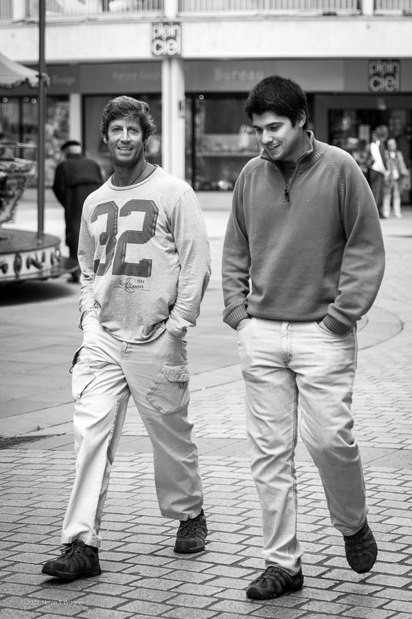 An early evening was a perfect time for two men to engage in conversation as they walked through the city.