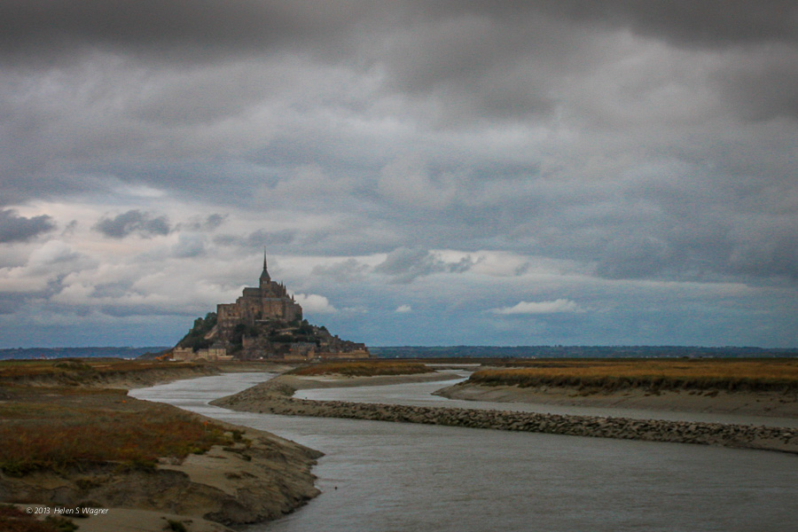 The view of the approach to Mont St-Michel in stormy weather is stunning.