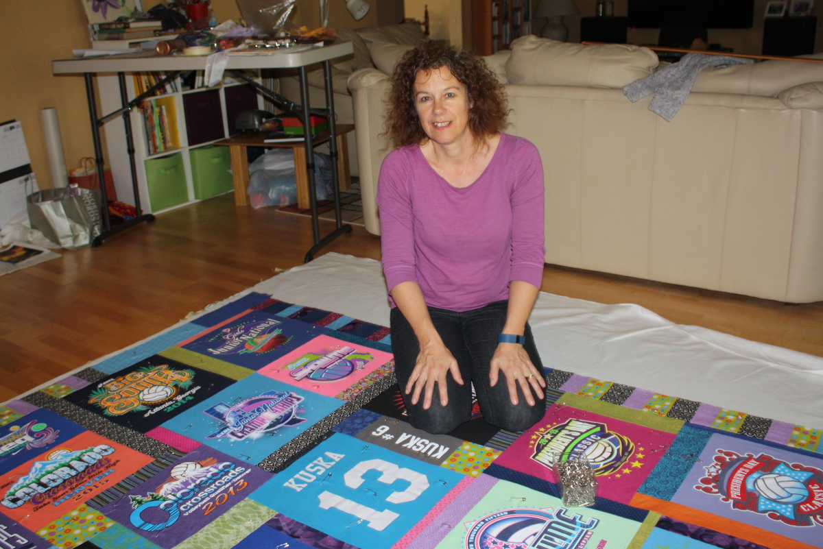 This is me today working on another t shirt quilt that will be a graduation gift in May.