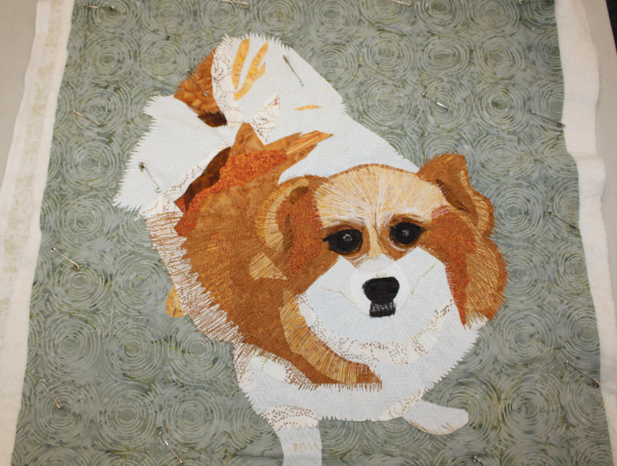 This sweet dog was stitched down with plenty of thread play bringing out his fluffy personality.