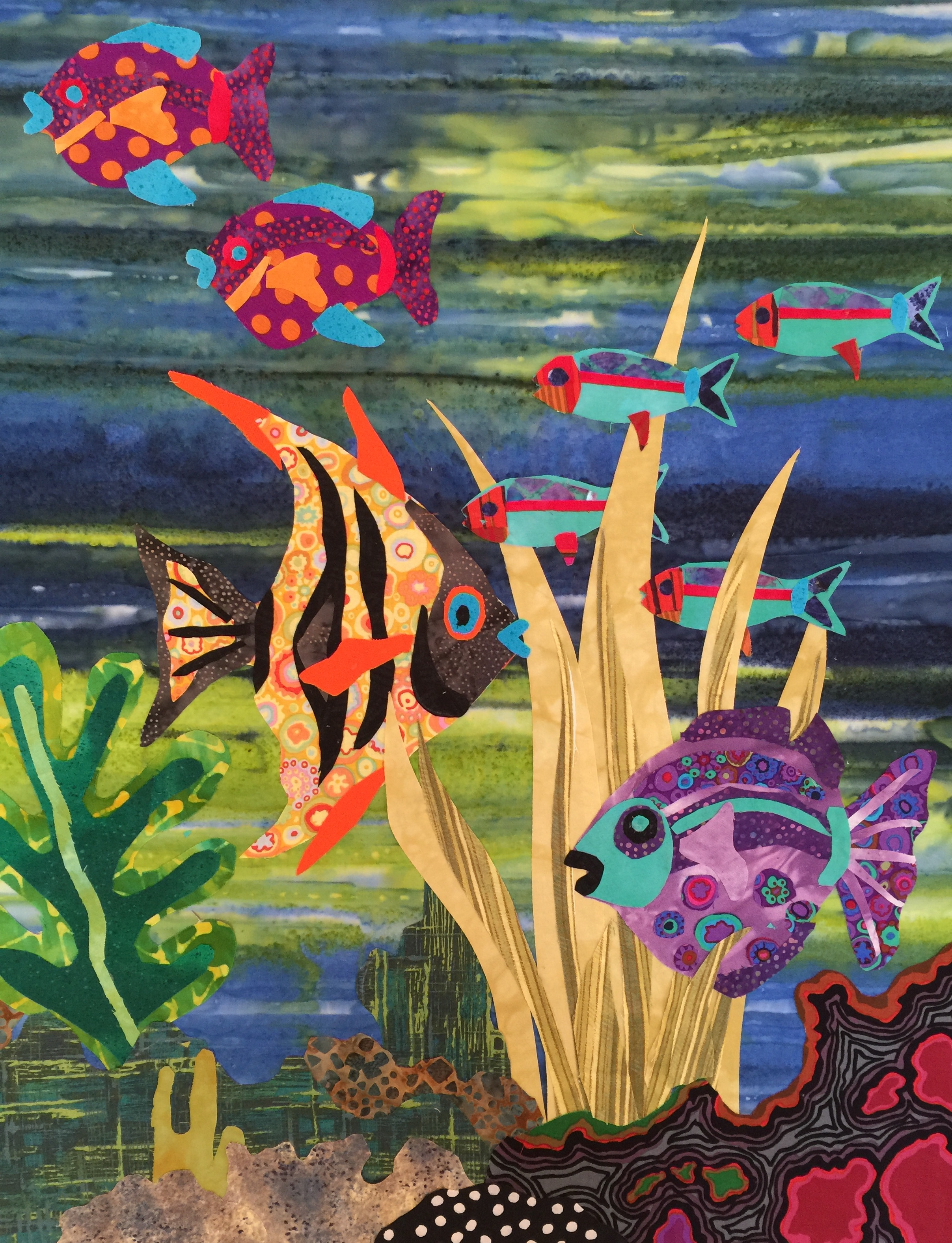 Fabulous Fish working with smaller fish on a decorative background