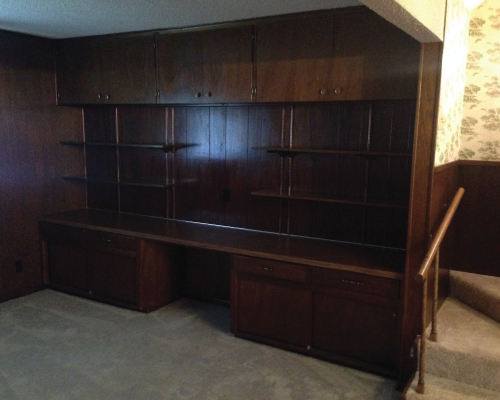 Check out the wood paneling and this dated office nook in the living room. WOOF!