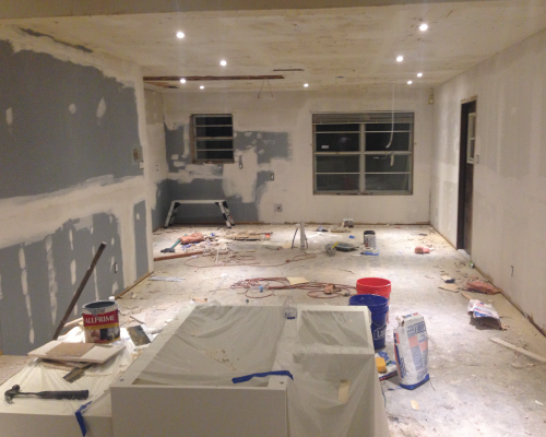 A view of the open dining/kitchen space from the living room.
