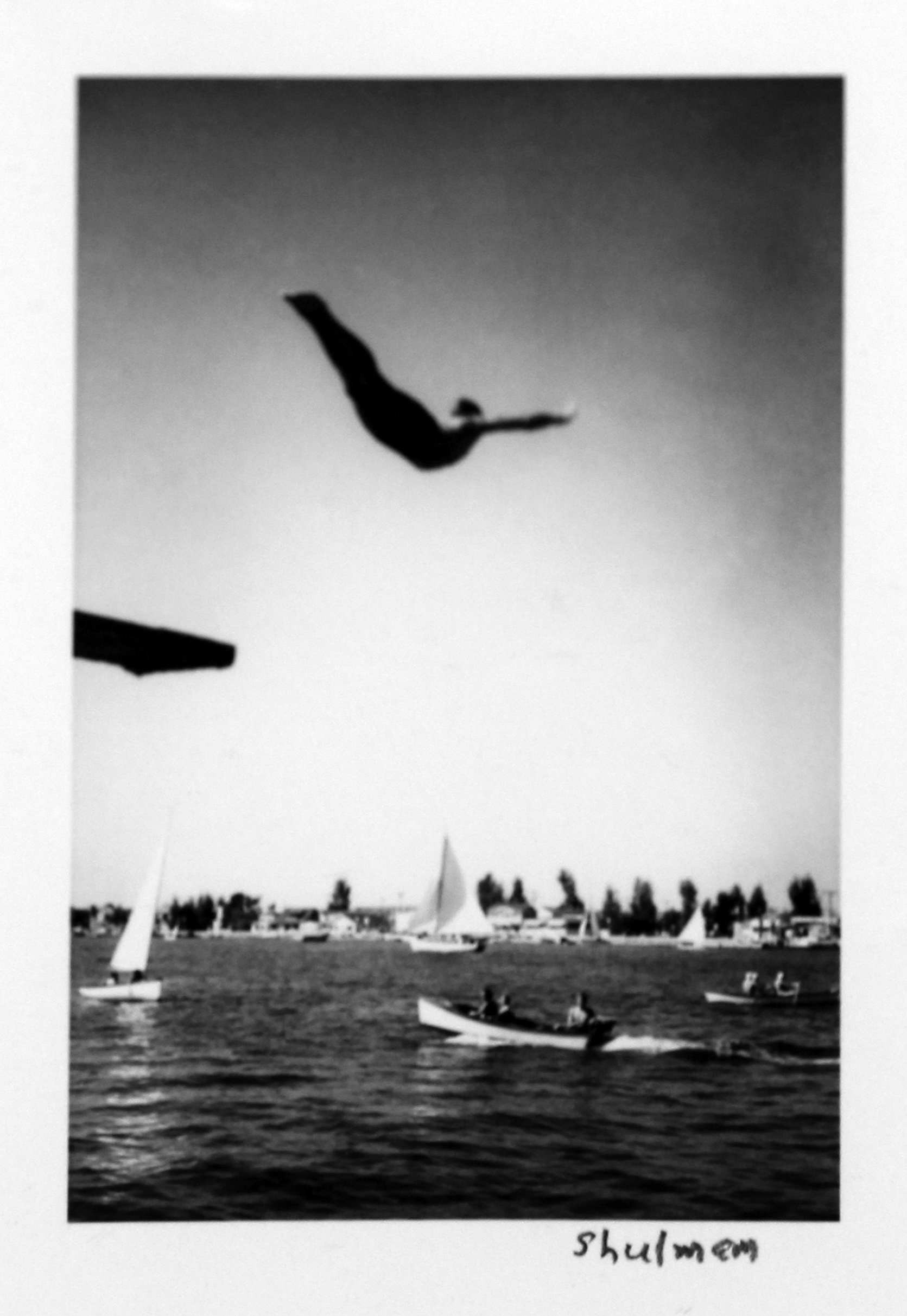 Julius Shulman  (American, 1910-2009)  Self-Portrait Diving into Newport Harbor, from the Vest Pocket Pictures series , 1930's/Printed Later Later gelatin silver print Signed on recto Image: 3 x 2 inches; Framed: 13.25 x 11.25 inches Provenance: The Estate of Ms. Gaby Stuart/Primus-Stewart Gallery, Los Angeles, CA Estimate: $1,500/$1,800