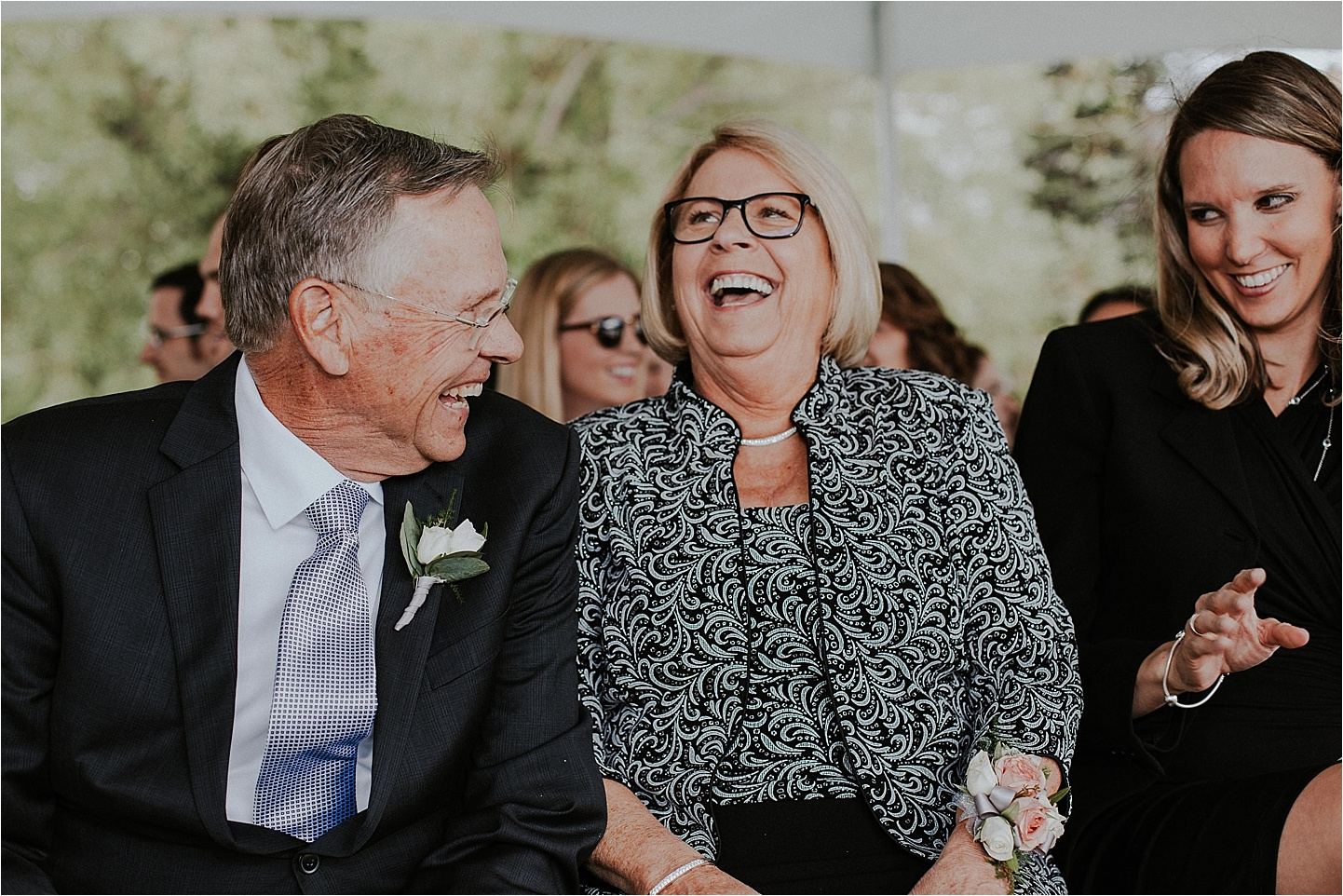 whitefish montana wedding guests laughing.jpg