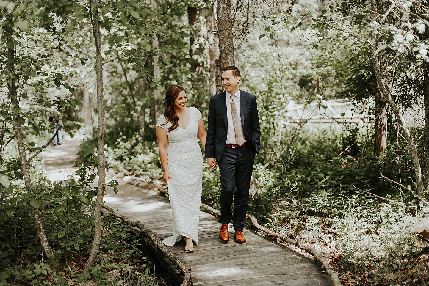 whitefish montana wedding walking through the forest.jpg