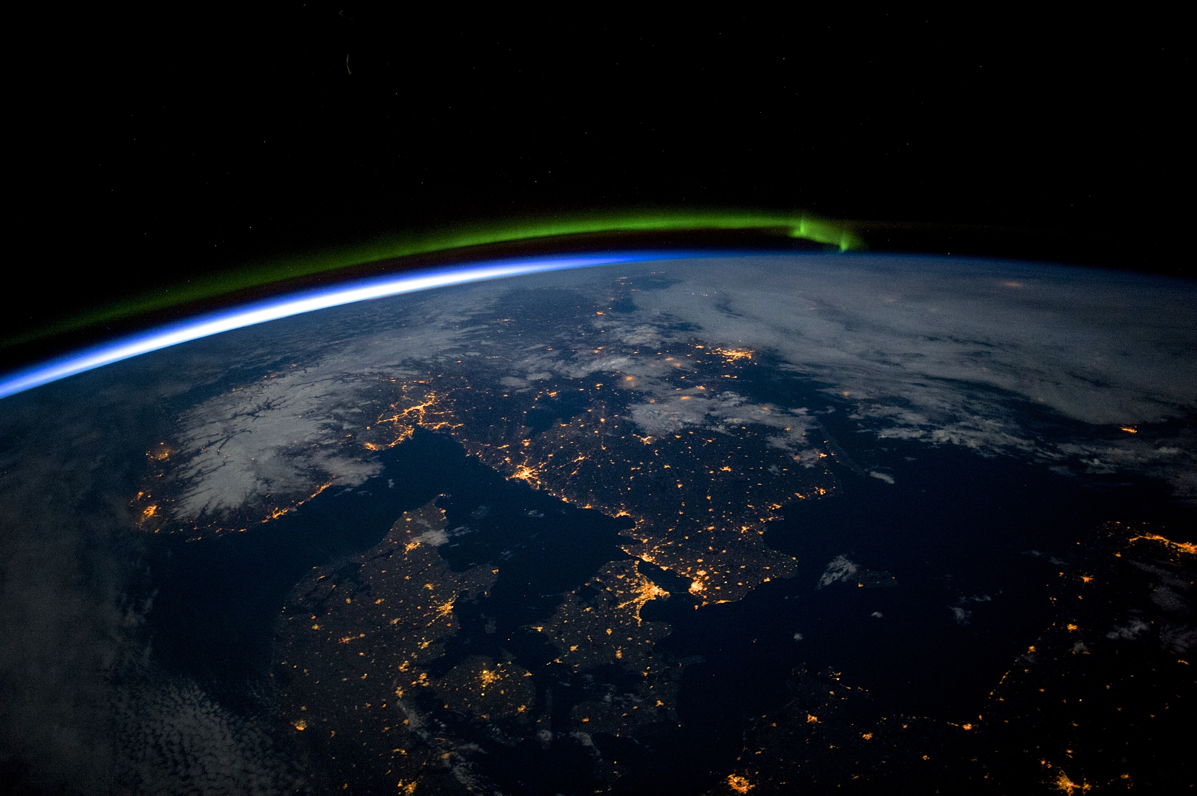 Astronauts aboard the International Space Station captured this photograph of southern Scandinavia on April 3, 2015. In the shot you can see a green aurora to the north, the blackness of the Baltic Sea (lower right), and clouds and snow in Norway illuminated by the full Moon (top right). Image courtesy of  Nasa.