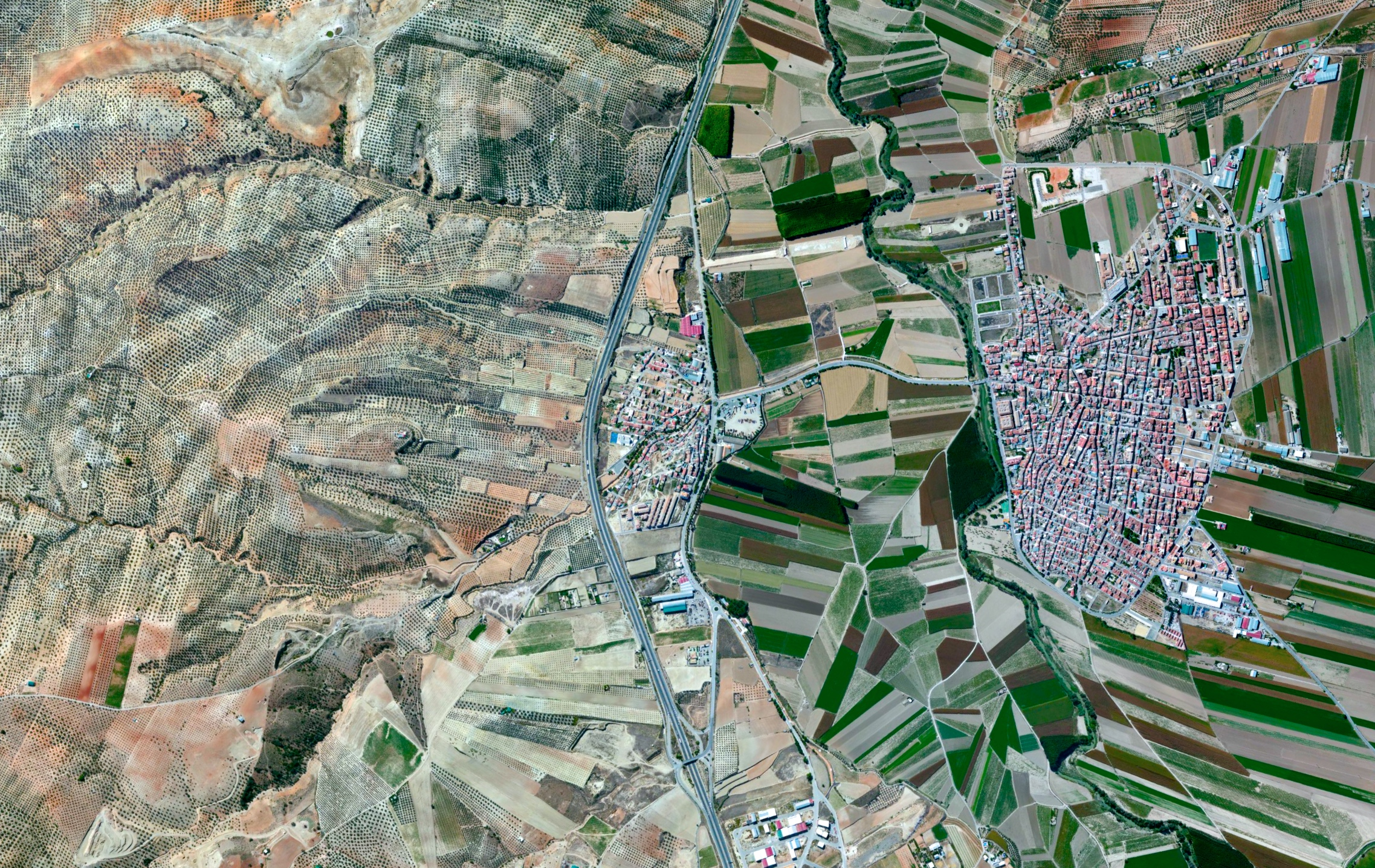 5/27/2015  Agricultural development  Huétor-Tájar, Granada, Spain  37°11′41″N 4°02′47″W     Agricultural development surroundsHuétor Tájar, a small town located in the province of Granada, Spain. The primary crops grown in the municipality are asparagus and olives.