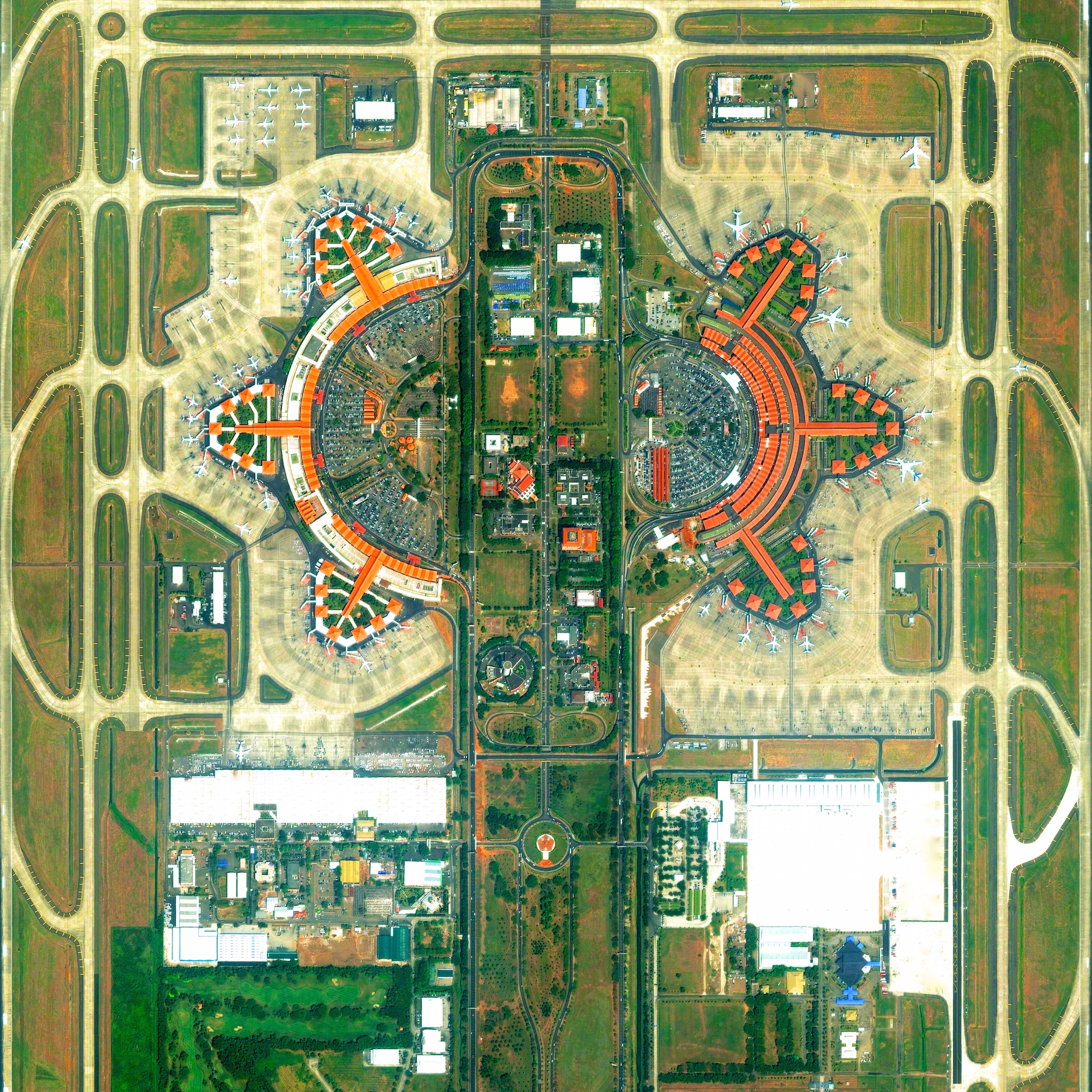 6/5/2015   Soekarno-Hatta International Airport   Jakarta, Java, Indonesia   -6.125556  ,  106.655833     Soekarno-Hatta International Airport in Jakarta, Indonesia is the 9th busiest airport in the world, serving approximately 57.8 million passengers each year. The boarding pavilions are examples of classic Indonesian architecture with roofs built in the Javanese stepped-roof style.