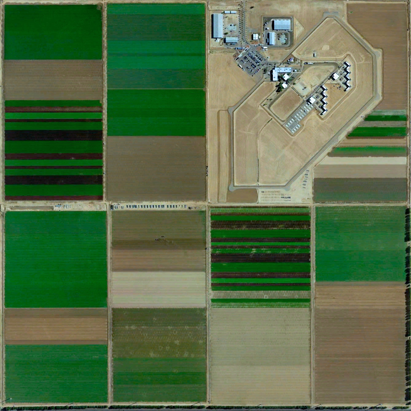 7/8/2015   Arizona State Prison Complex - Perryville   Goodyear, Arizona, USA  33°28′14″N 112°26′30″W    The Arizona Department of Corrections facility in Goodyear, Arizona is surrounded by fields of lettuce, cabbage, and red potatoes. The prison holds 2,382 inmates across eight housing units (only one is pictured here). This Overview is part of a collaborative photo essay that we just released with Fusion to detail how prisons have become a part of the American landscape, often in plain sight. Check out the full story  here .