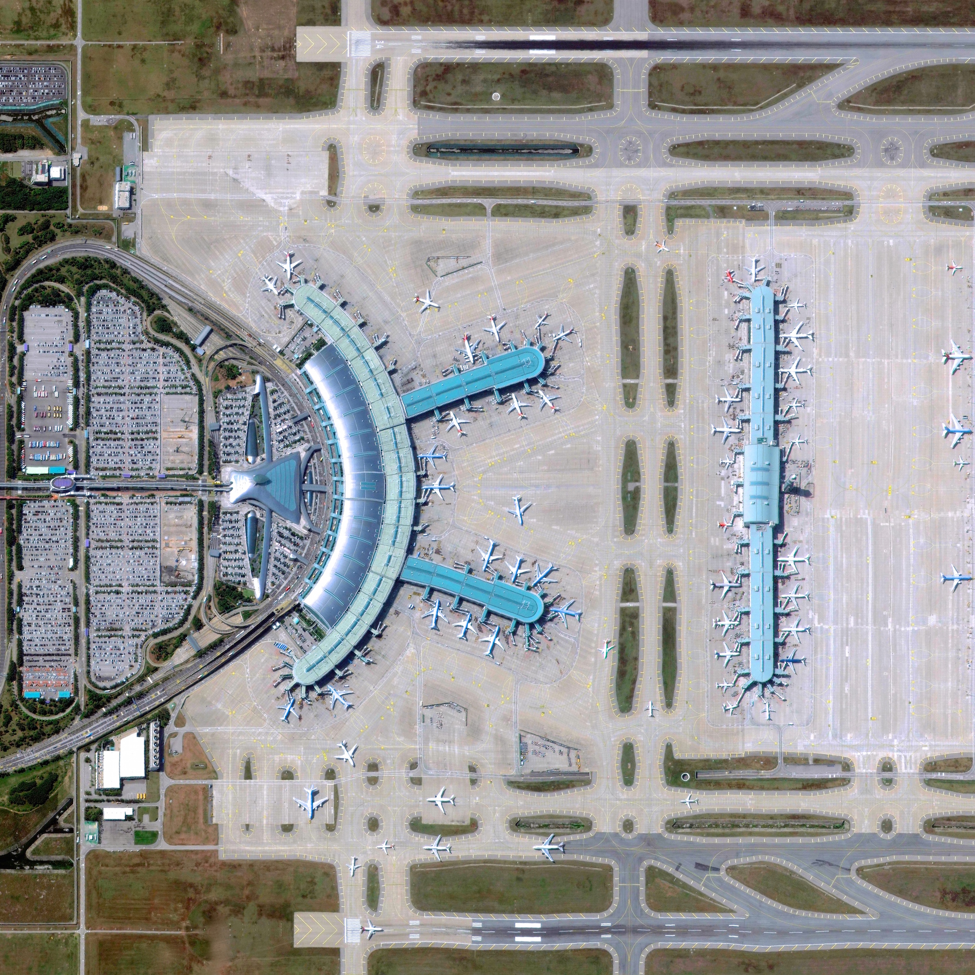 7/9/2015   Incheon International Airport   Incheon, South Korea  37°27′48″N 126°26′24″E    Incheon International Airport is located thirty miles west of Seoul, South Korea. The airport is one of the busiest in the world (23rd by annual passenger traffic at 47+ million) and also one of the most efficient. Airport authorities claim that the average departure and arrival at Incheon take only 19 minutes and 12 minutes, respectively. These times are significantly lower than the international average of 60 minutes for departures and 45 minutes for arrivals.