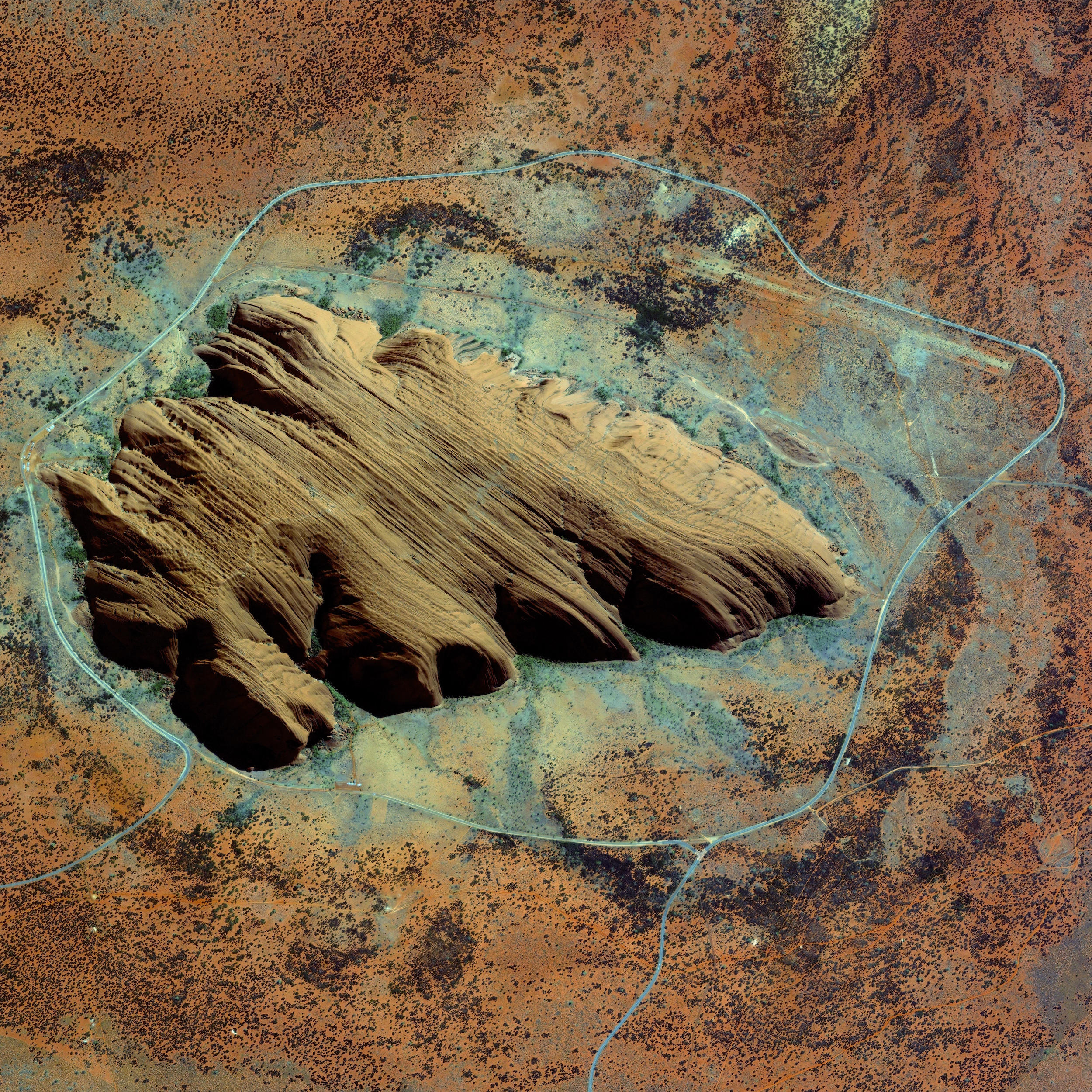 7/17/2015   Uluru / Ayers Rock   Northern Territory, Australia  25°20′42″S 131°02′10″E    Uluru, or Ayers Rock, is a large sandstone formation in the Northern Territory of Australia. The monolith - towering 1141 feet high with an expanse of 2.2 x 1.2 miles - is a sacred site to the Aboriginal people of the area who first settled there 10,000 years ago. While the first Australian tourists arrived at Uluru in 1936, annual visitor numbers rose to over 400,000 by the year 2000. Increased tourism at the site provides regional and national economic benefits, but also creates an ongoing challenge to balance conservation, cultural values, and visitor needs.