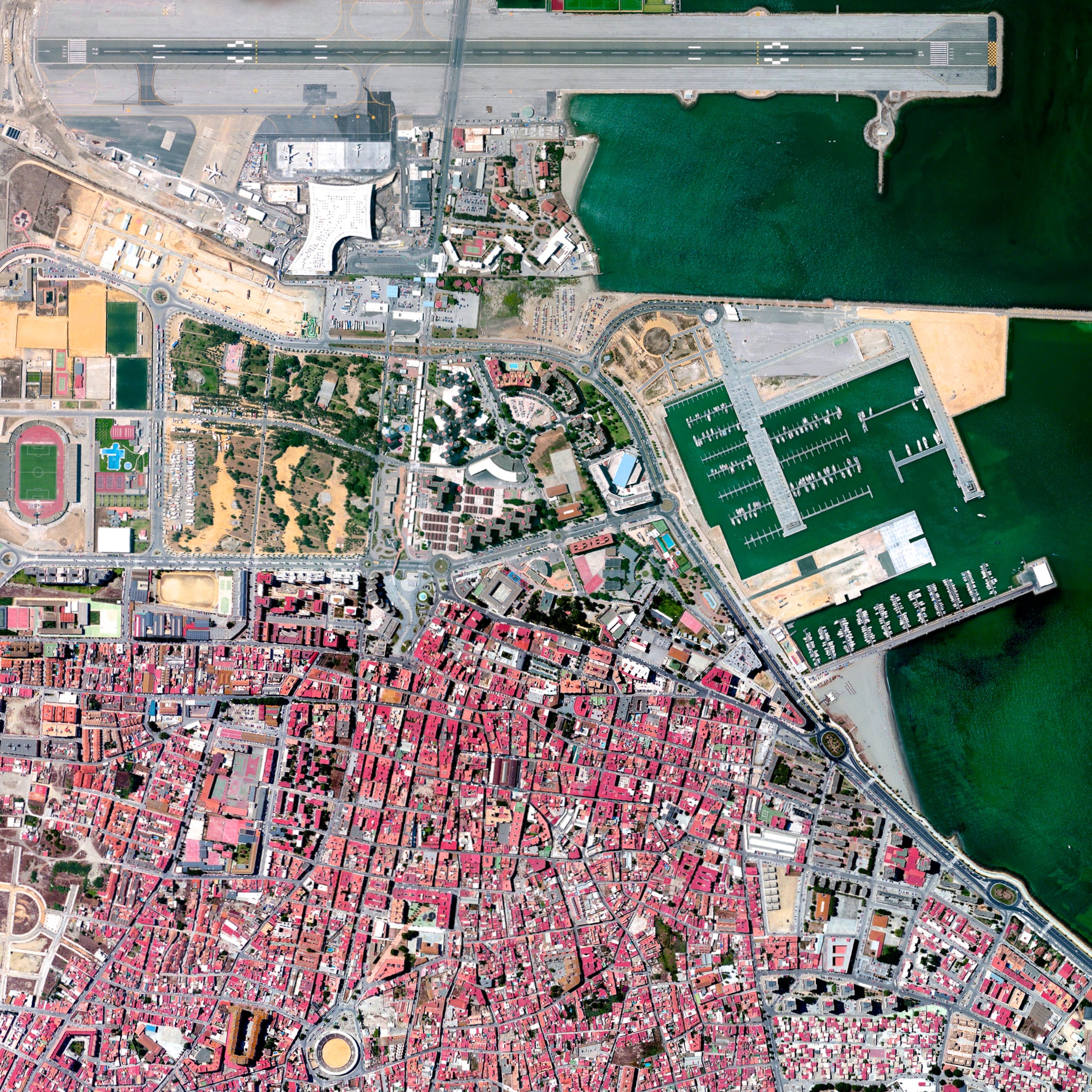 7/27/2015   Gibraltar International Airport   Gibraltar  36°09′04″N 005°20′59″W    Check out this zoomed-in look at  one of the prints  that was added to our store yesterday. The Overview captures the Gibraltar International Airport, serving the British overseas territory and neighboring areas of southern Spain. Winston Churchill Avenue - the road to the border with Spain - intersects the airport runway and has to be closed every time a plane lands or departs. To see what else is in the Printshop,  click here !