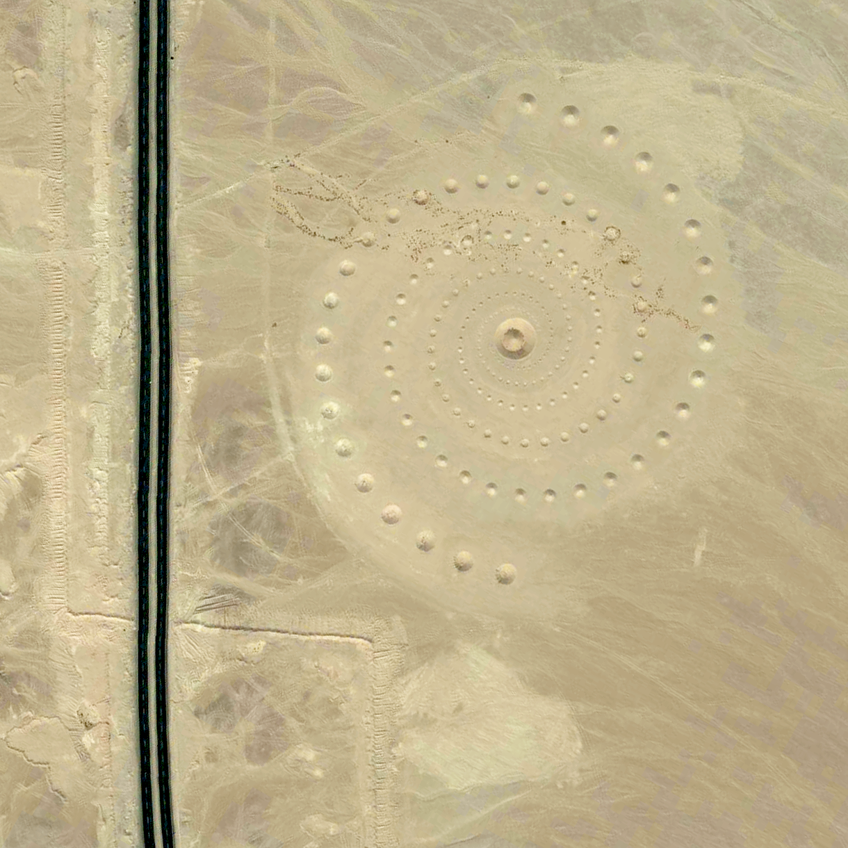 """8/8/2015   Desert Breath   Hurghada, Egypt  27.380541787°, 33.634132451°    """"Desert Breath"""" - located in the Egyptian desert near Hurghada on the Red Sea - is a double-spiral art piece. Because the 89 protruding cones that make up one spiral are constructed from the sand that was dug to create the 89 depressed cones of the other spiral, in due time, with erosion, the area of approximately one million square feet will revert back to its original state."""