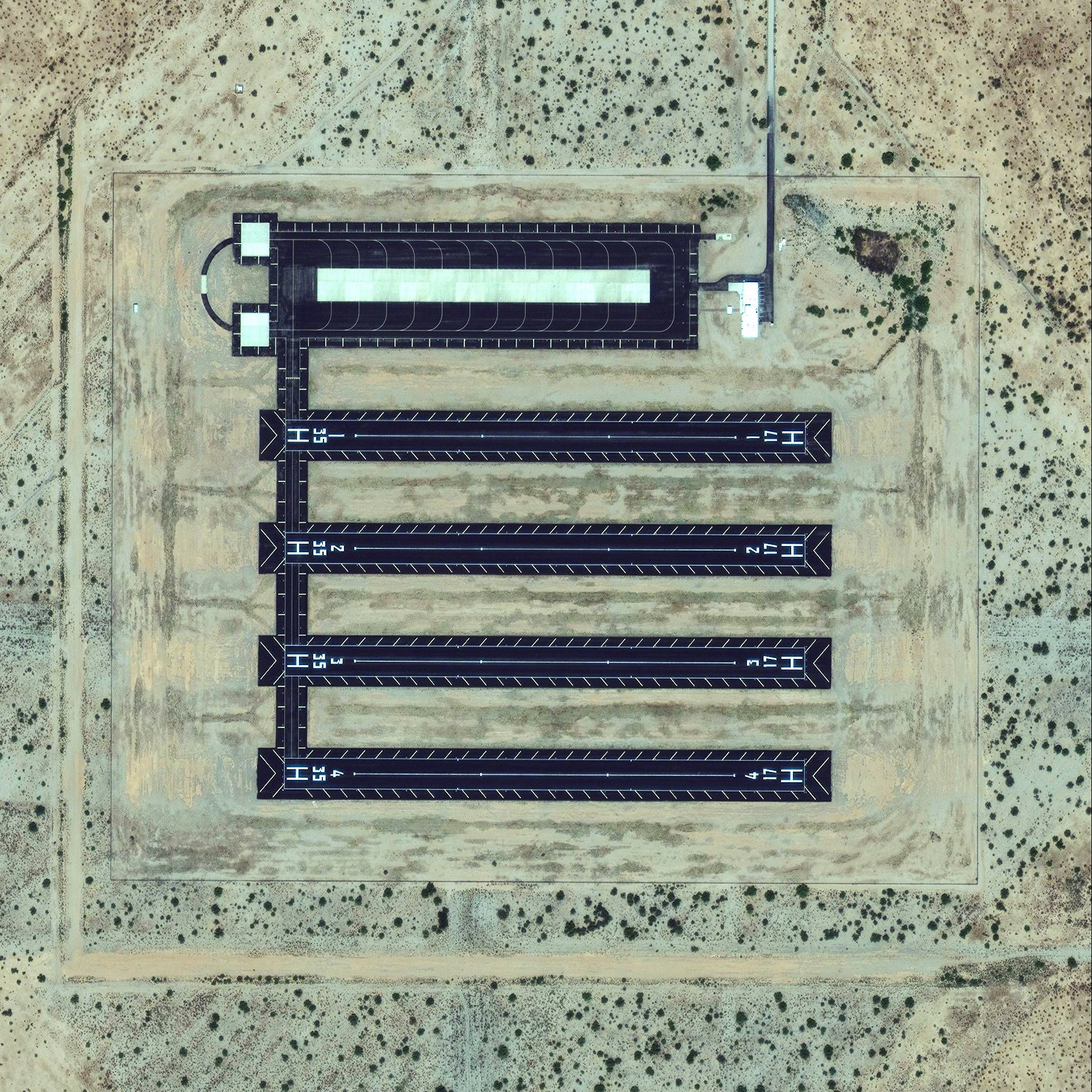 8/29/2015  Landing strips  Eloy, Arizona, USA  32.663367, -111.487618    Multiple landing strips are visible in Eloy, Arizona, USA. Can anyone figure out what they are used for? It's a mystery to us too!