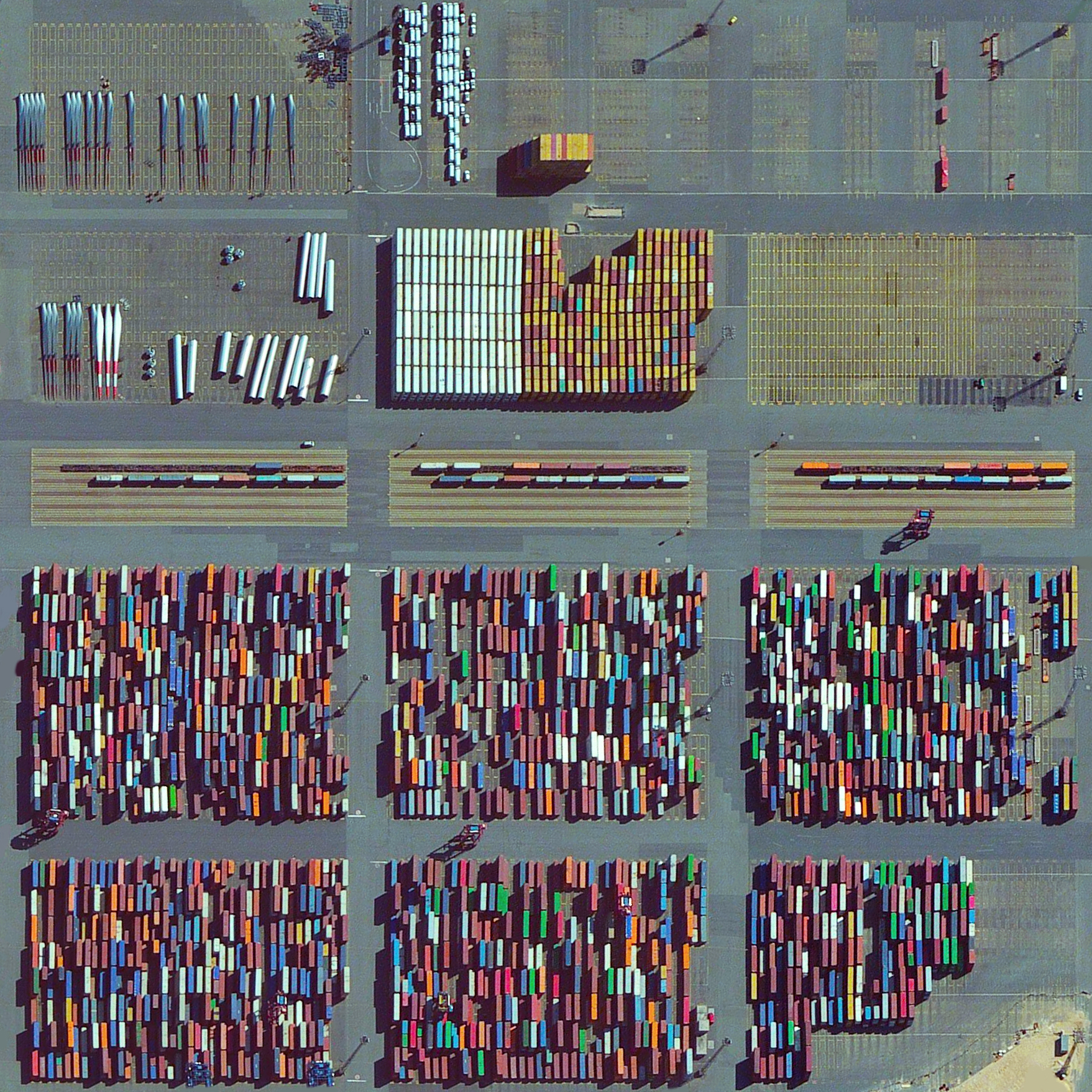 8/30/2015   Bremerhaven Port   Bremen, Germany  53.584444960°, 8.536846512°    Thousands of items including shipping containers, wind turbine blades, and automobiles are prepared for transport at the Bremerhaven Port in Bremen, Germany. At any given moment, the port contains between 60,000 and 80,000 vehicles and it serves as the 23rd busiest port in the world with 5,831 thousand TEU's moved each year. With this post we'll be signing off on vacation for the week and look forward to more posts when we get back!
