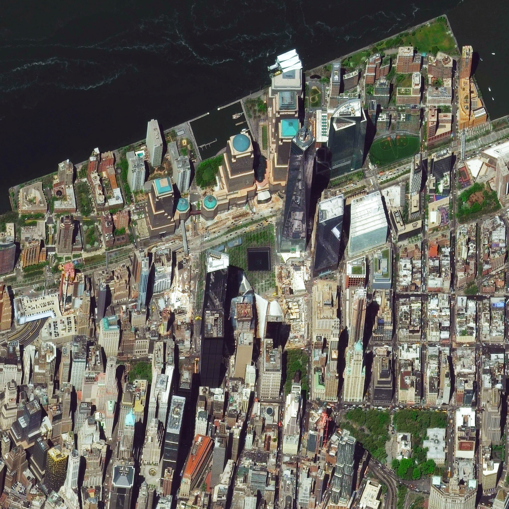 9/11/2015   One World Trade Center   New York, New York, USA  40.7129465, -74.0117528    Today marks the 14th anniversary of the September 11th attacks in the United States. At the center of this Overview, we can see One World Trade Center and the North Pool of the 9/11 Memorial in downtown Manhattan, New York City.