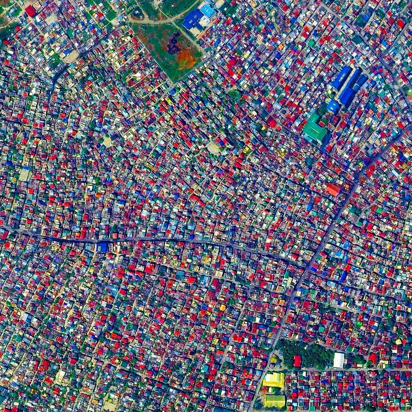 9/17/2015   Pasig   Manila, Philippines  14.541245999°, 121.104281301°    The City of Pasig is one of the highly urbanized areas in Manila, Philippines. Formerly a rural settlement, the city now contains mostly residential and industrial buildings and has been becoming increasingly commercial in recent years. The colorful roofs that dot the landscape are common in the Manila region.