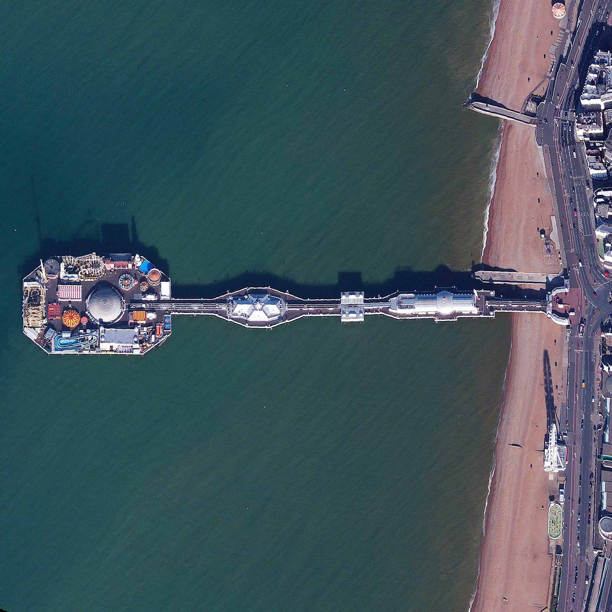 9/26/2015   Brighton Pier   Brighton, England  50.816387979°, -0.137252700°    Brighton Pier, also known as Palace Pier, is constructed off the coast of the English city of Brighton. Extending 1,719 feet (524 meters) into the English Channel, the structure contains numerous restaurants, rides, and roller coasters.