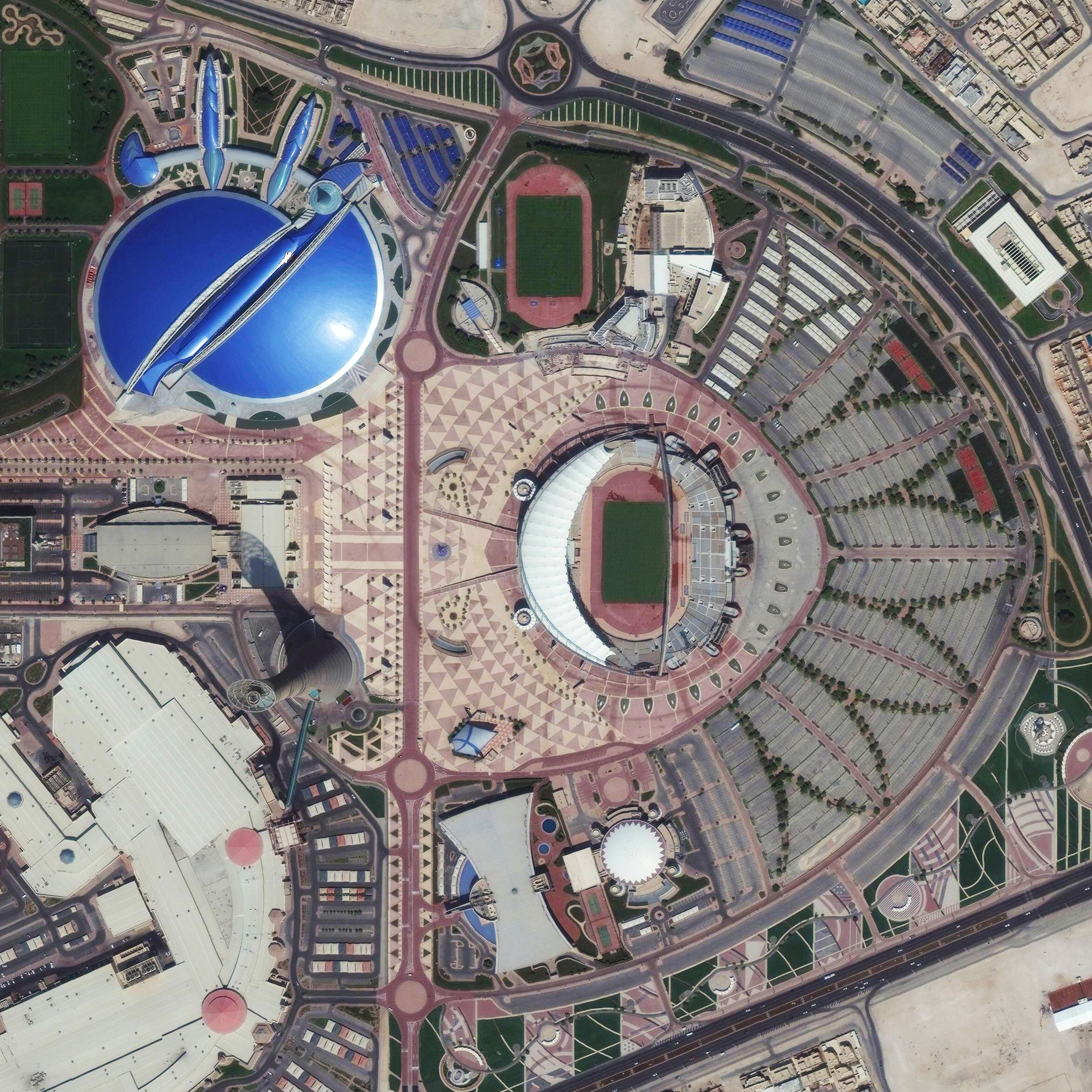 10/21/2015   Khalifa International Stadium   Doha, Qatar  25°15′49.19″N 51°26′53.08″E     Khalifa International Stadium is a massive sports complex in Doha, Qatar. The facility is currently undergoing a massive renovation and expansion in advance of the 2022 World Cup, which will be hosted by the Qataris. The blue structure adjacent to the stadium is Aspire Academy, a youth sports school.