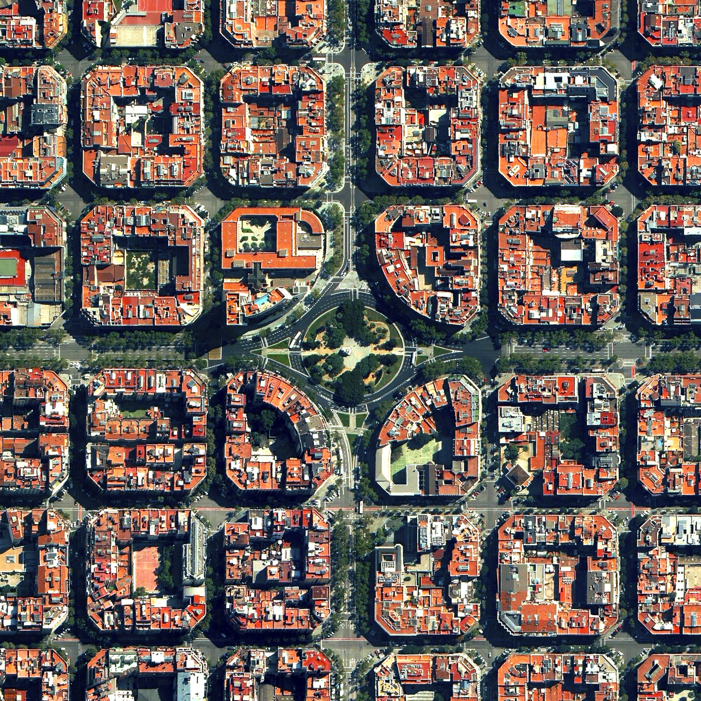 10/28/2015   Eixample   Barcelona, Spain  41°23′27″N 2°09′47″E     The Eixample District in Barcelona, Spain is characterized by its strict grid pattern and apartments with communal courtyards. This thoughtful and visionary design was the work of Ildefons Cerdà. His plan features broad streets that widen at octagonal intersections to create greater visibility with increased sunlight, better ventilation, and more space for short-term parking.