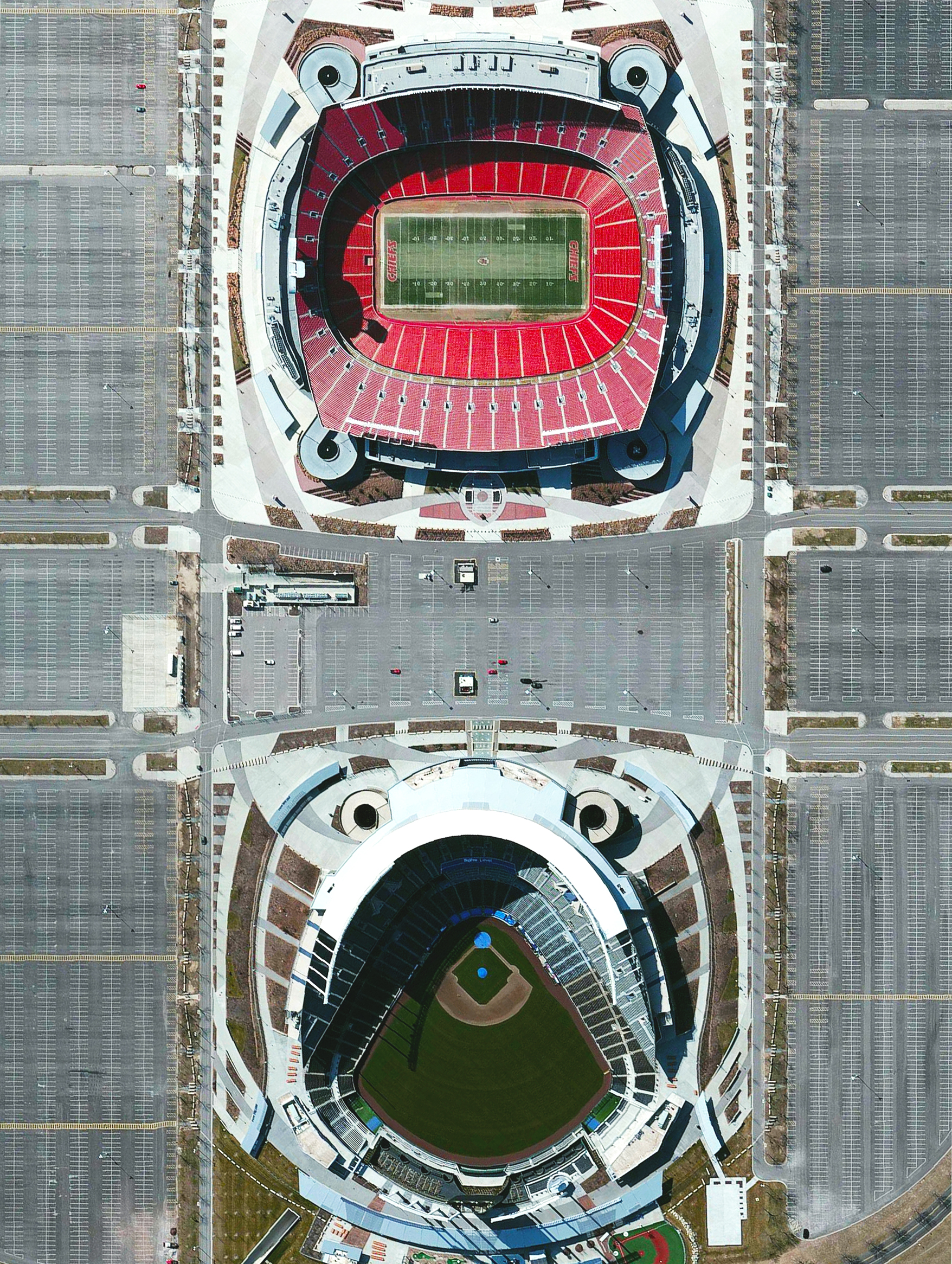 11/3/2015   Arrowhead Stadium  /  Kauffman Stadium   Kansas City, Missouri  39°3′5″N 94°28′50″W    Arrowhead Stadium and Kauffman Stadium are home to the Kansas City Chiefs (football) and Kansas City Royals (baseball). It was a great weekend for both teams as the Chiefs defeated the Detroit Lions and the Royals triumphed over the New York Mets to win the World Series. The combined seating capacity of the stadiums is 114,319.