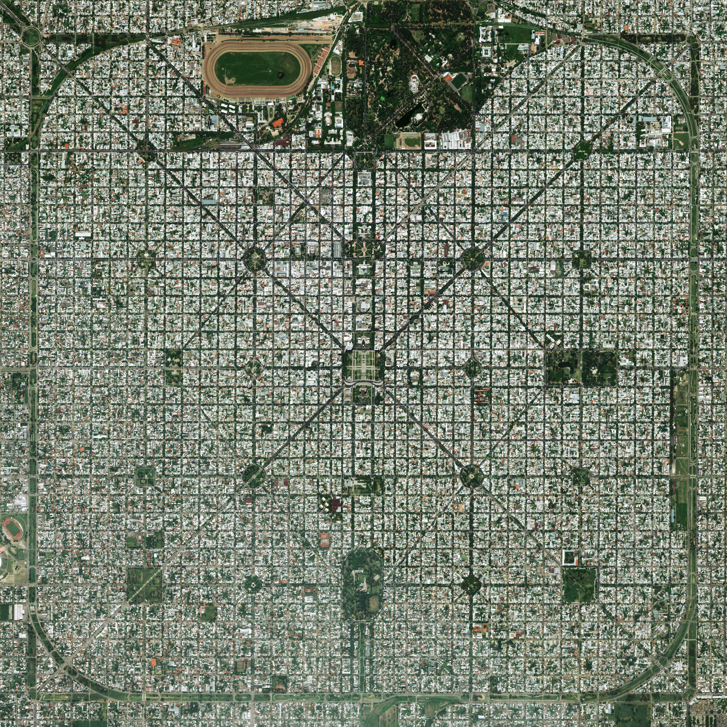 """11/6/2015   La Plata   Buenos, Aires, Argentina  34°55′16″S 57°57′16″W    The planned city of La Plata, the capital city of the Province of Buenos Aires, is characterized by its strict grid pattern. At the 1889 World's Fair in Paris, the new city was awarded two gold medals for the """"City of the Future"""" and """"Better performance built."""""""