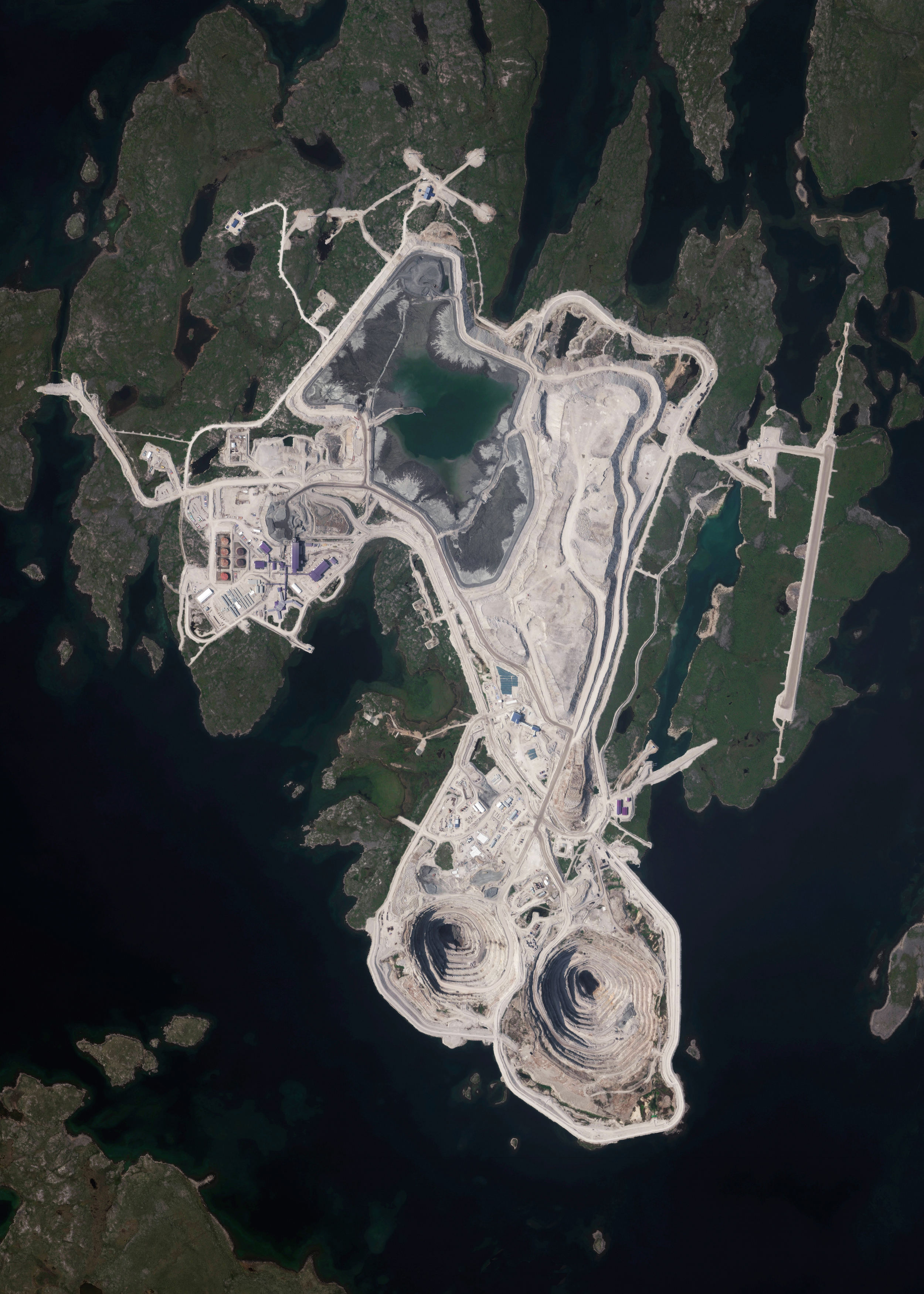 11/18/2015   Diavik Diamond Mine    Northwest Territories, Canada   64.496111100°, -110.273333300°    The Diavik Diamond Mine is located on the Lac de Gras lake in the Northwest Territories of Canada, 120 miles (193km) south of the Arctic Circle. The mine produces approximately 7.5 million carats of diamonds each year. In standard weight, that's an annual output of 1500 kilograms or 3,300 pounds. In this Overview, the most distinguishable areas of the facility are its two primary open pits, waste ponds, processing facilities, and an airstrip capable of landing aircraft as large as 737s and C-130s.