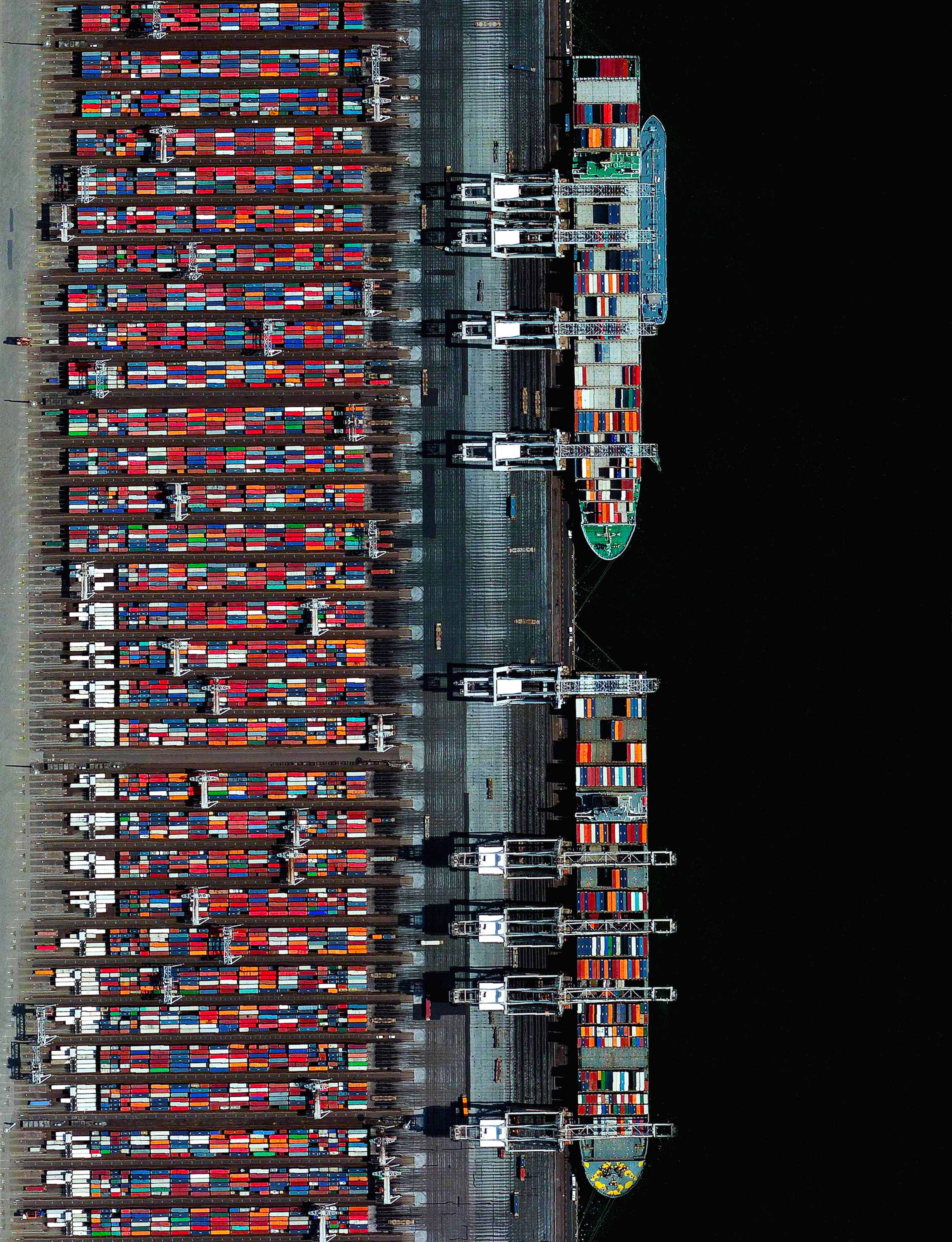 11/21/2015   Port of Rotterdam   Rotterdam, Netherlands  51.950990461°, 4.065449412°    Two container ships are docked at the Port of Rotterdam in the Netherlands. From 1962 until 2002 it was the world's busiest port, but was overtaken first by the the port in Singapore and later by the facility in Shanghai, China. Container ships such as these can weigh up to 300,000 tons and extend up to 1,200 feet (366 meters).