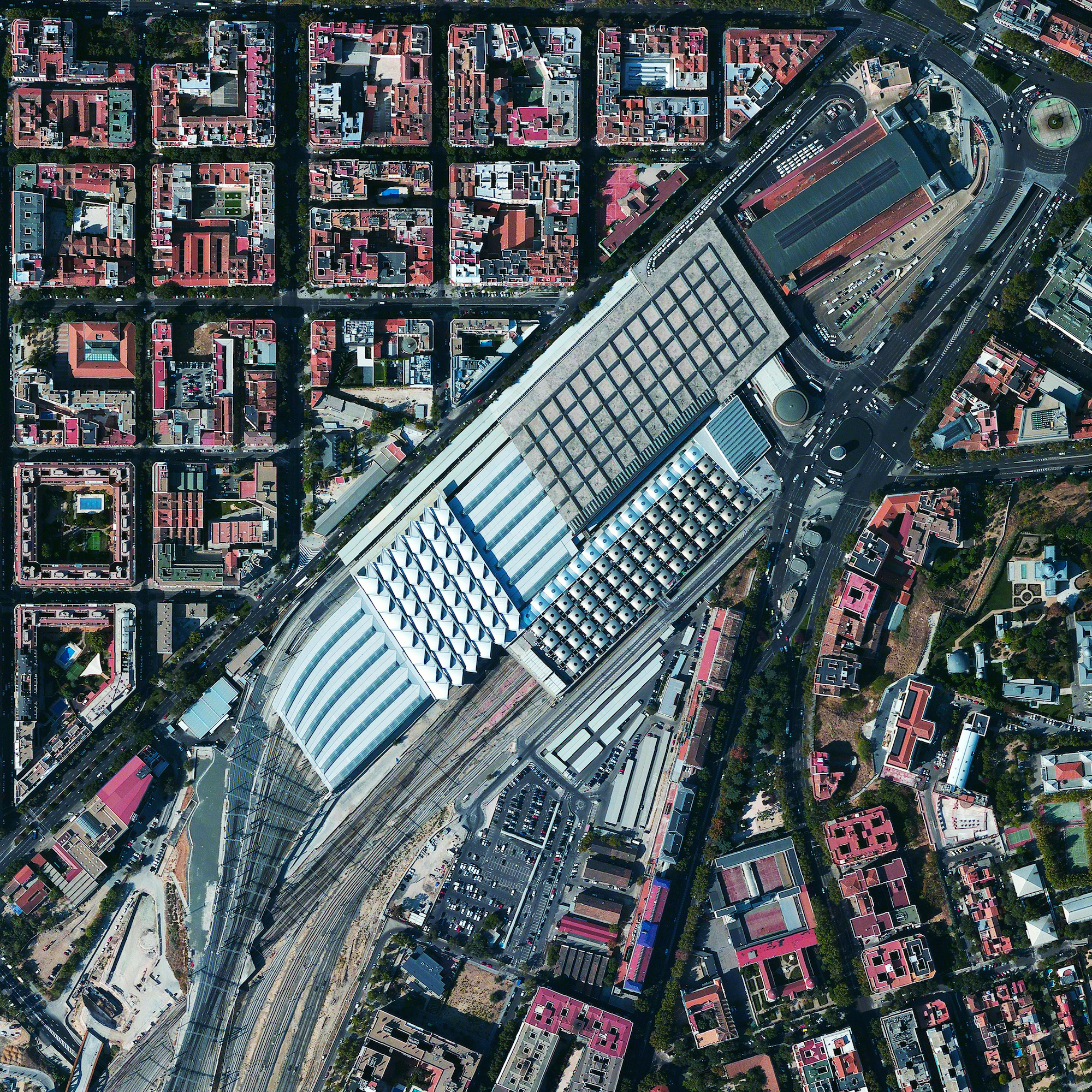 12/16/2015   Madrid Atocha Railway Station   Madrid, Spain  40°24′24″N 3°41′22″W    The Atocha Railway Station is the largest train station in Madrid, Spain. The facility serves as a hub for commuter trains, intercity and regional trains from the south, and AVE high-speed trains. In 1992, the station's original terminal building was converted into a concourse with shops, a nightclub, and a 43,055 square foot tropical botanical garden.