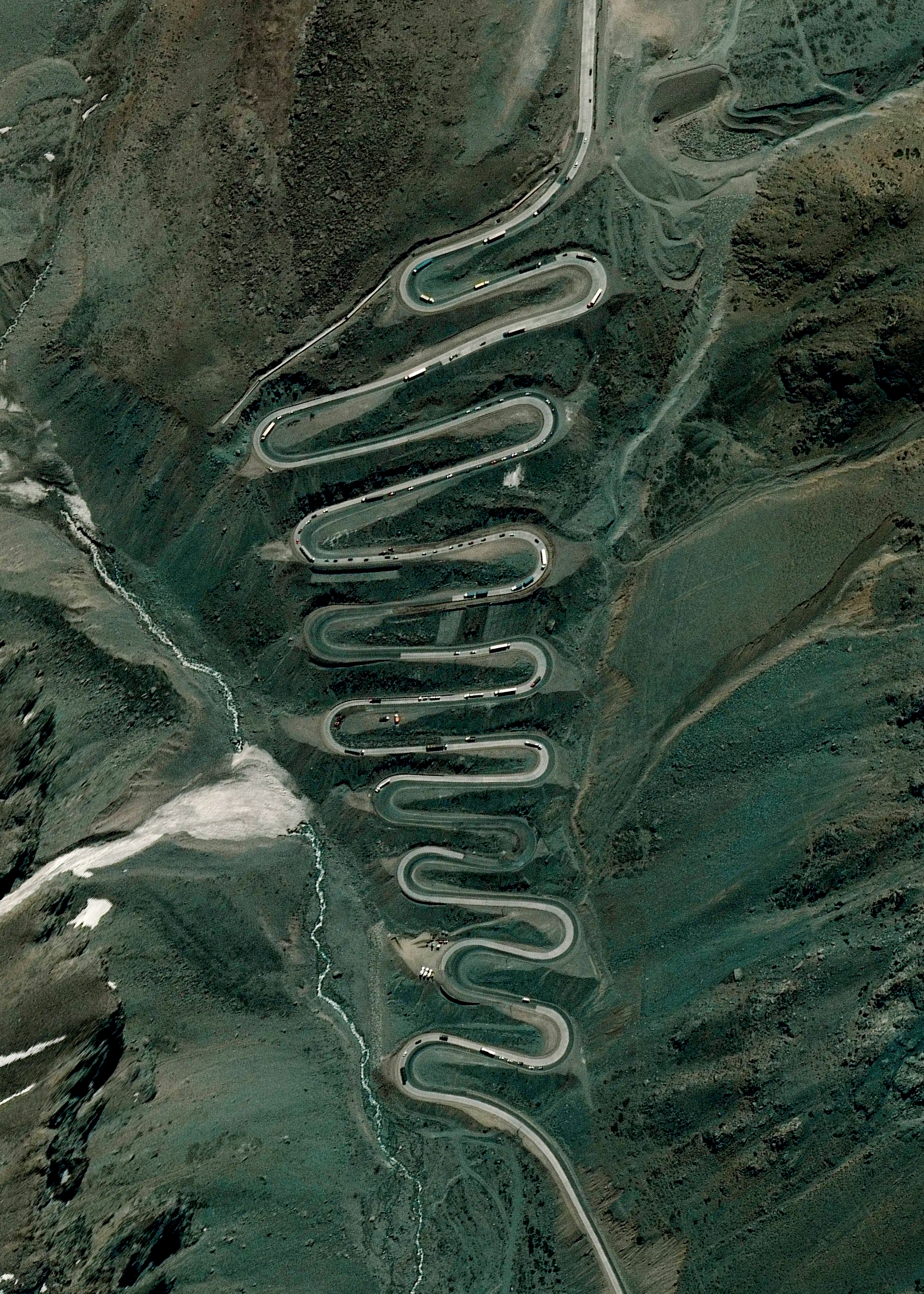 """1/7/2016   Los Caracoles Pass   Andes Mountains  32°51'6""""S 70°8'16""""W    Los Caracoles Pass, or The Snails Pass, is a twisting mountain road located in a remote section of the Andes Mountains on the Chilean side of the border with Argentina. The path climbs to an elevation of 10,419 feet, has no roadside safety barriers, and is frequented by large trucks."""