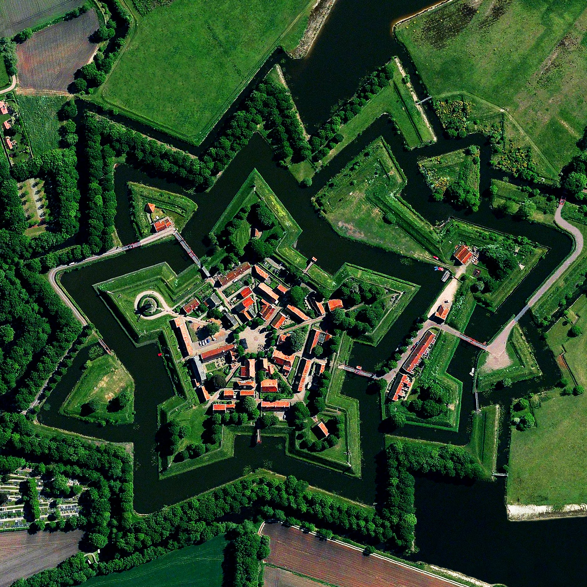 1/13/2016   Bourtange   Bourtange, Netherlands  53.0066°N 7.1920°E    Bourtange is a star fort located in the Netherlands. The complex was built in 1593 in the manner you see here so that an attack on any of its five walls could be aggressively counteracted from the two adjacent star points. The village currently has an occupation of 430.