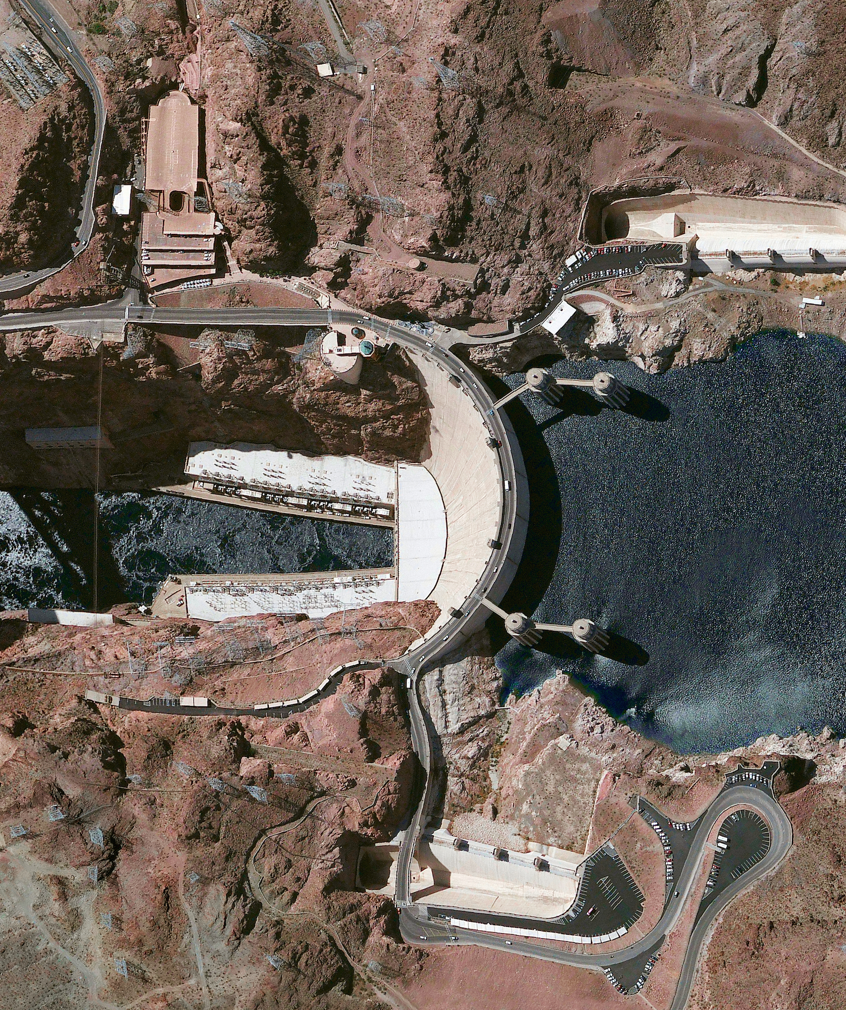 2/16/2016   Hoover Dam   Nevada /Arizona, USA  36°0′56″N 114°44′16″W    Hoover Dam is a 726-foot high, 1,244-foot wide concrete arch-gravity dam located on the Colorado River at the border of Arizona and Nevada. Constructed between 1931 and 1936 during the Great Depression, a workforce of approximately 20,000 poured a total of 4.36 million cubic yards of concrete to complete the structure. That is enough concrete to pave a two-lane highway from San Francisco to New York City.