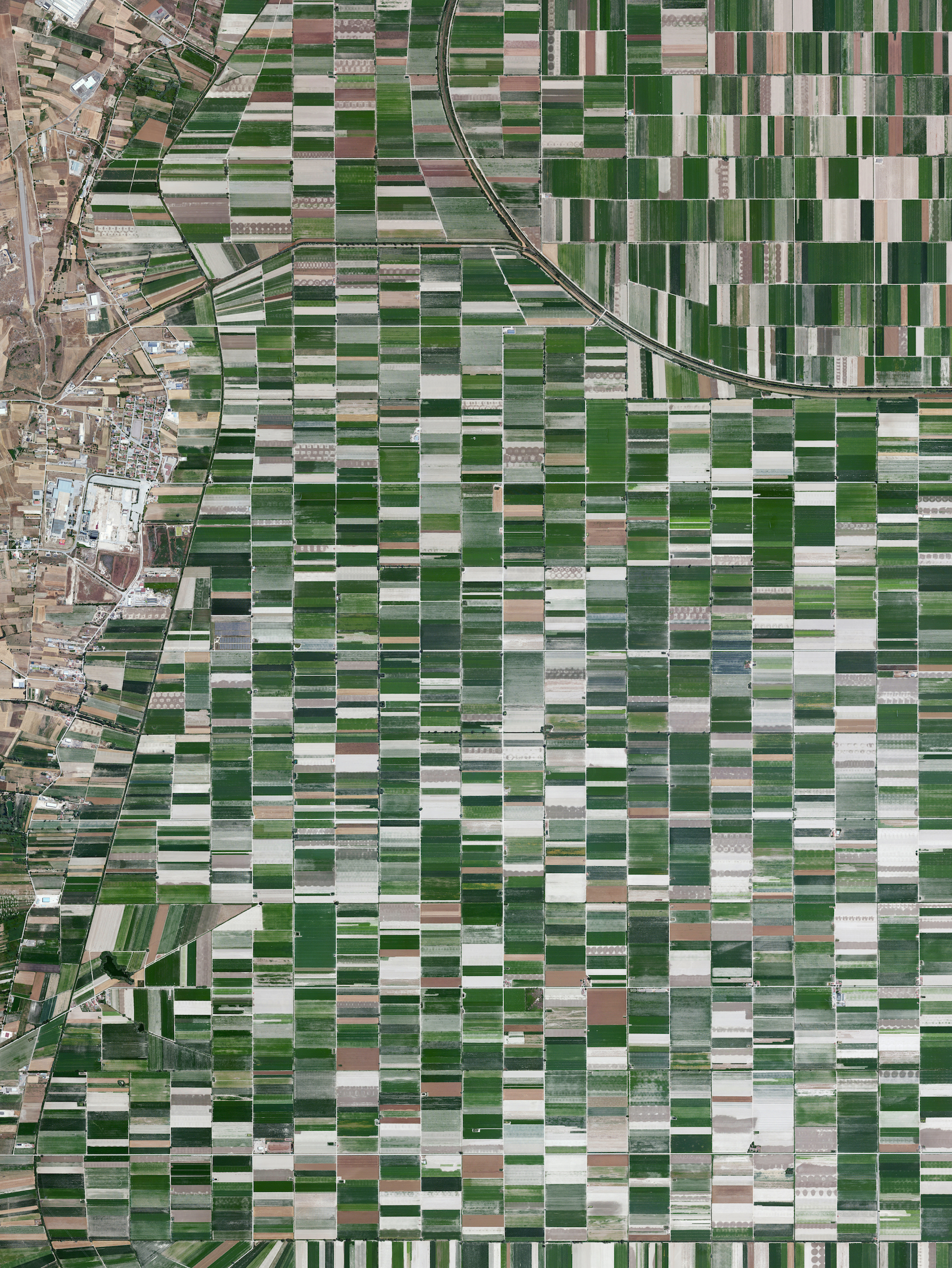 4/13/2016  Plain of Fucino  Abruzzo, Italy  42.0043709, 13.5290608     The plain of Fucino in the Abruzzo region of Italy is commonly recognized for the quality of the vegetables that are grown here - in particular the potatoes, carrots, and radishes. What is now an entire plain filled with farms was once Fucine Lake, the third largest lake in Italy. The lake was drained in 1877 to make agricultural development possible here, an area that is now responsible for roughly 25% of the agricultural production in the region.