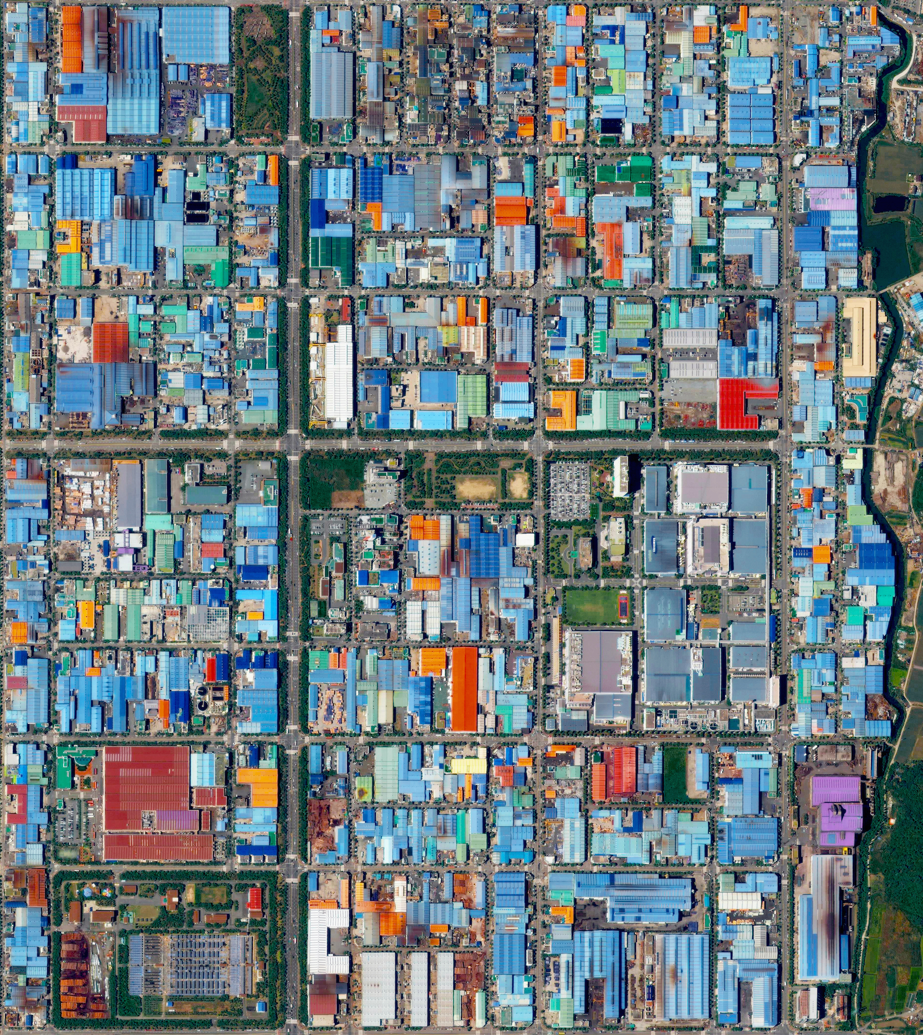 4/25/2016  Songjeong Dong  Busan, South Korea  35.0931874, 128.849009     The colorful roofs of Songjeong-dong - an industrial district in Busan, South Korea - are seen in this Overview. The striking colors that you see here result from the use of aluminum roofing, which is used for its low cost and longevity.