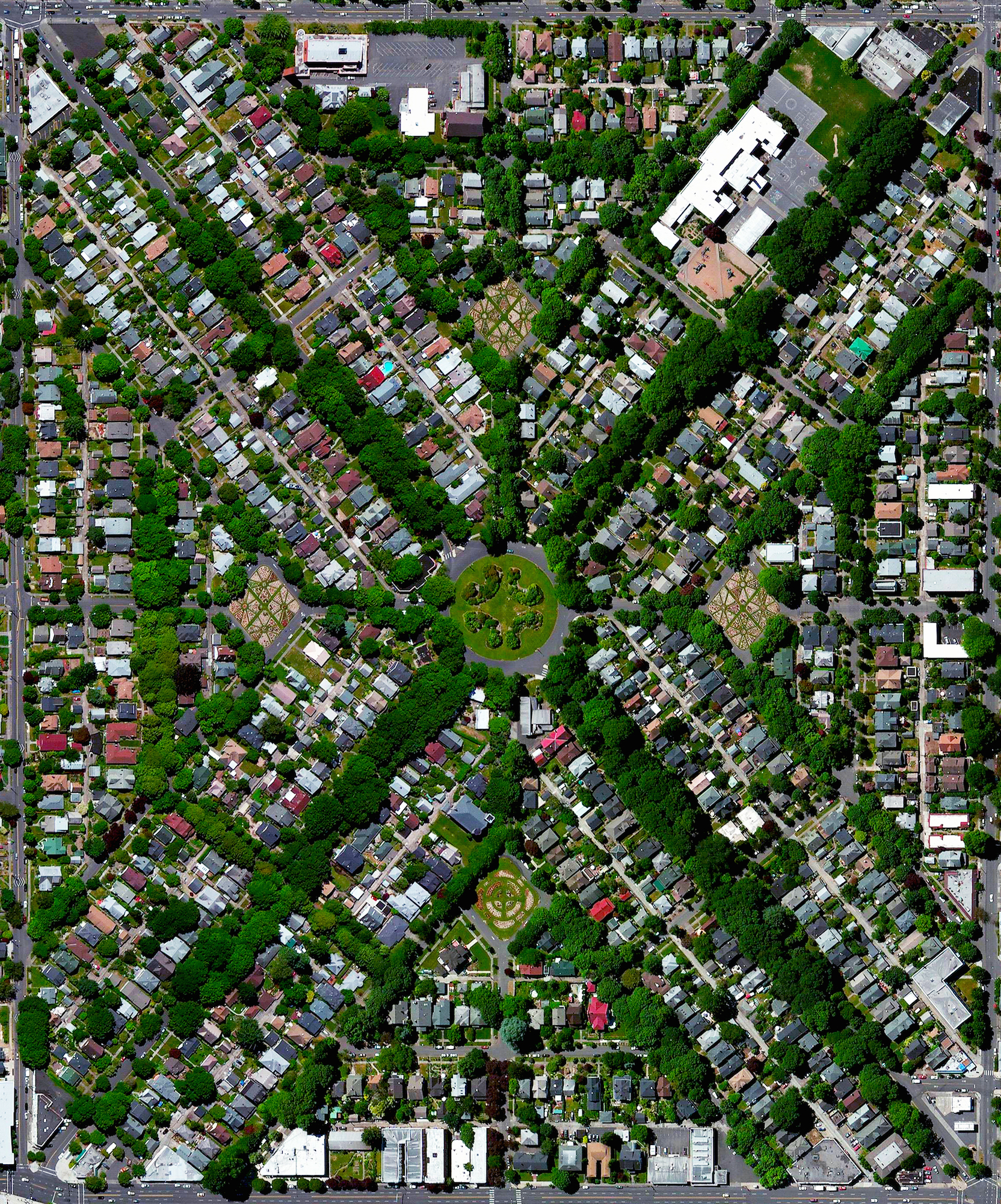 """5/2/2016   Ladd's Addition   Portland, Oregon, USA  45°30′31″N 122°38′58″W    In one week I'll be traveling to the wonderful city of Portland, Oregon!  This Overview shows Ladd's Addition - Portland's oldest planned residential development. The neighborhood is recognizable with its diagonal street streets that are lined with American elm trees. Inspired by the L'Enfant Plan in Washington, D.C., the area is laid out in a """"wagon wheel"""" arrangement that contains four diamond-shaped rose gardens and a traffic circle surrounding a central park."""