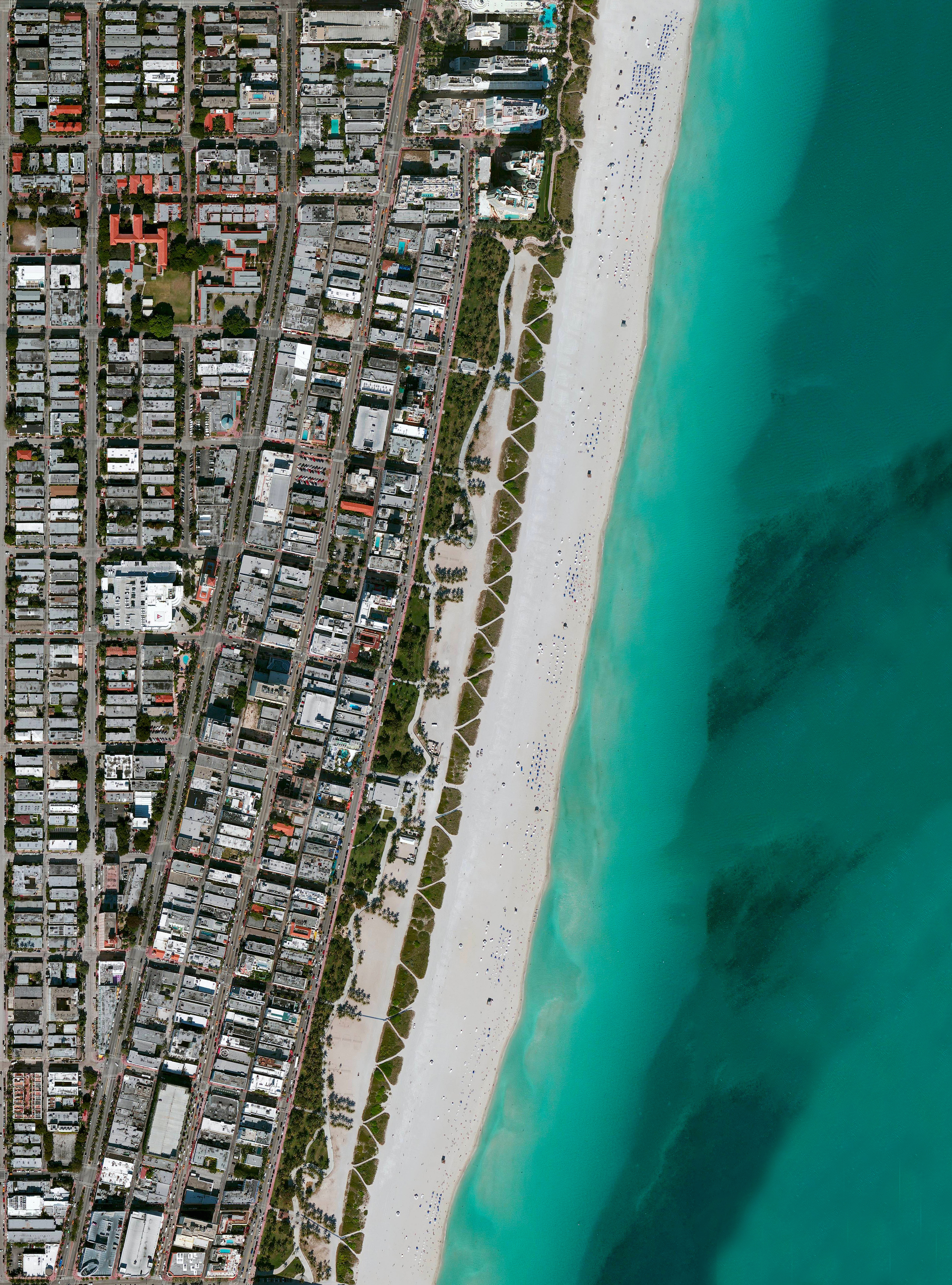 5/27/2016  Miami Beach  Miami Beach, Florida, USA  25.783742, -80.128644    Umbrellas and beachgoers dot the sands of Miami Beach, Florida, USA. This area is one of the most popular tourist destinations in the country, attracting nearly 15 million visitors each year. The #summer season officially starts this weekend with Memorial Day here in the United States, but I wish everyone a few days of rest and adventure wherever you are around the world!